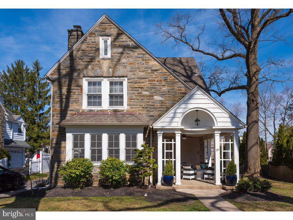 Welcome home to this beautifully renovated 2.5 Story Classic Stone Colonial in the coveted Merion Golf Manor neighborhood. Here is a home with charm galore and true architectural interest.  As you approach the home you will note a covered front porch with decorative wood columns and an outdoor fan. Once inside you will find gleaming hard wood flooring and neutrally colored recently painted walls. The front entry foyer has a coat closet and an interesting recessed space to accommodate shoes, gloves, keys and more.  Enter the living room through original glass paned French doors to a breathtaking wood burning natural stone fireplace flanked by built in book cases on either side. The numerous paned windows allow for ample natural light. The living room opens to a totally renovated kitchen including white mission style cabinetry, a spacious island with black leathered granite, upscale GE stainless steel appliances, recessed lighting & Murano glass Pendants (2012). Directly off of the kitchen is an eat-in area that will accommodate a table and chairs and is accented by a crescent shaped recessed wall cabinet and wainscoting.  Additional renovations include first floor powder room & laundry area (2016). The second- floor landing opens to a master bedroom, two auxiliary bedrooms and a den/multi-purpose room. The tastefully redesigned master bath (2013) has a gray tile floor, a glass enclosed stall shower and a pedestal sink. There is a second full bathroom with a shower tub combination in the hallway. It has the original tile of yesteryear in excellent condition.  Hardwood flooring and neutral colored paint throughout the second and third floor except in the bathrooms. Additional storage is provided by a large cedar closet. Up the steps to the spacious third floor, currently being used as a guest bedroom, could also serve as a family room or au-pair suite. The exposed stone wall and original claw foot tub add to the appeal. Additional highlights of this home include Heatin
