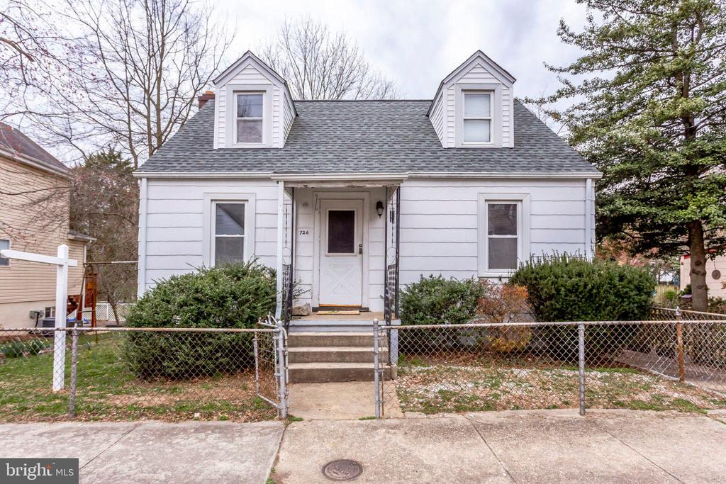 LOCATION, LOCATION, LOCATION! A COMMUTERS DREAM! Approx. 1/2 mile to Ballston Metro, restaurants, shopping and multiple major commuter routes! Cape cod home with 3 beds, two baths, hardwood floors, enclosed porch and lots of potential. Found on a quiet street and backs to Lubber Run Stream. This home will not last!