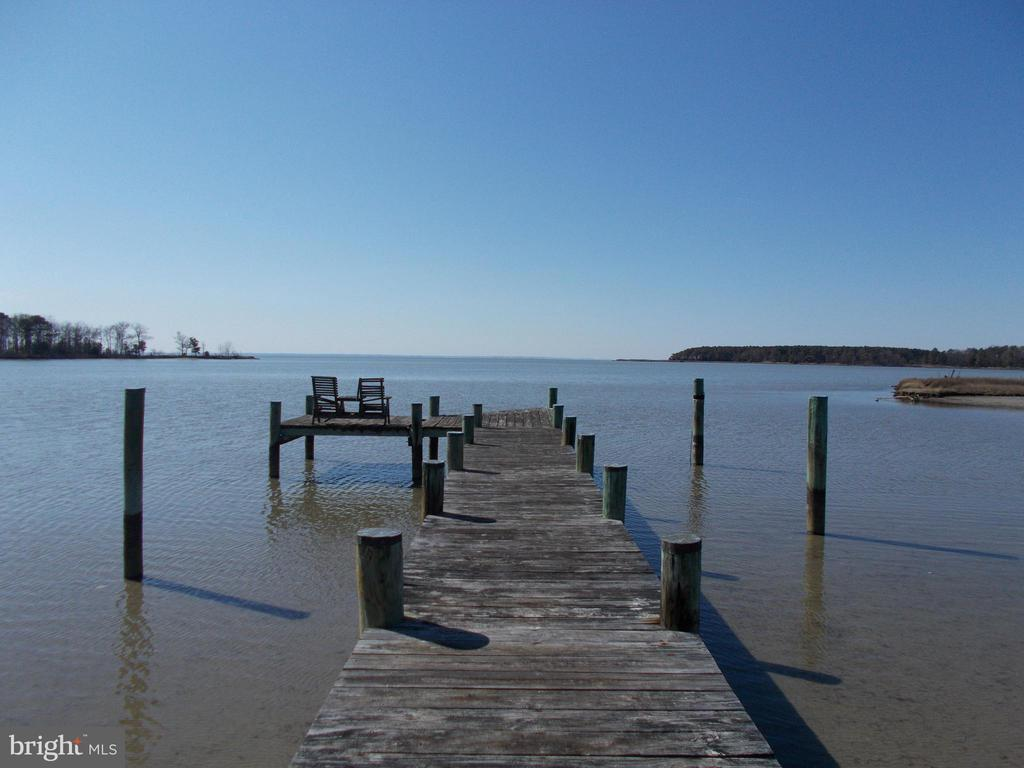Fabulous waterfront lot with dock already built! Enjoy wide water views and gorgeous sunsets.  Fully approved and ready for your new home. Well already installed.  Wonderful crabbing and fishing. Just minutes to the Chesapeake Bay. Close to town.  Well established premier neighborhood.