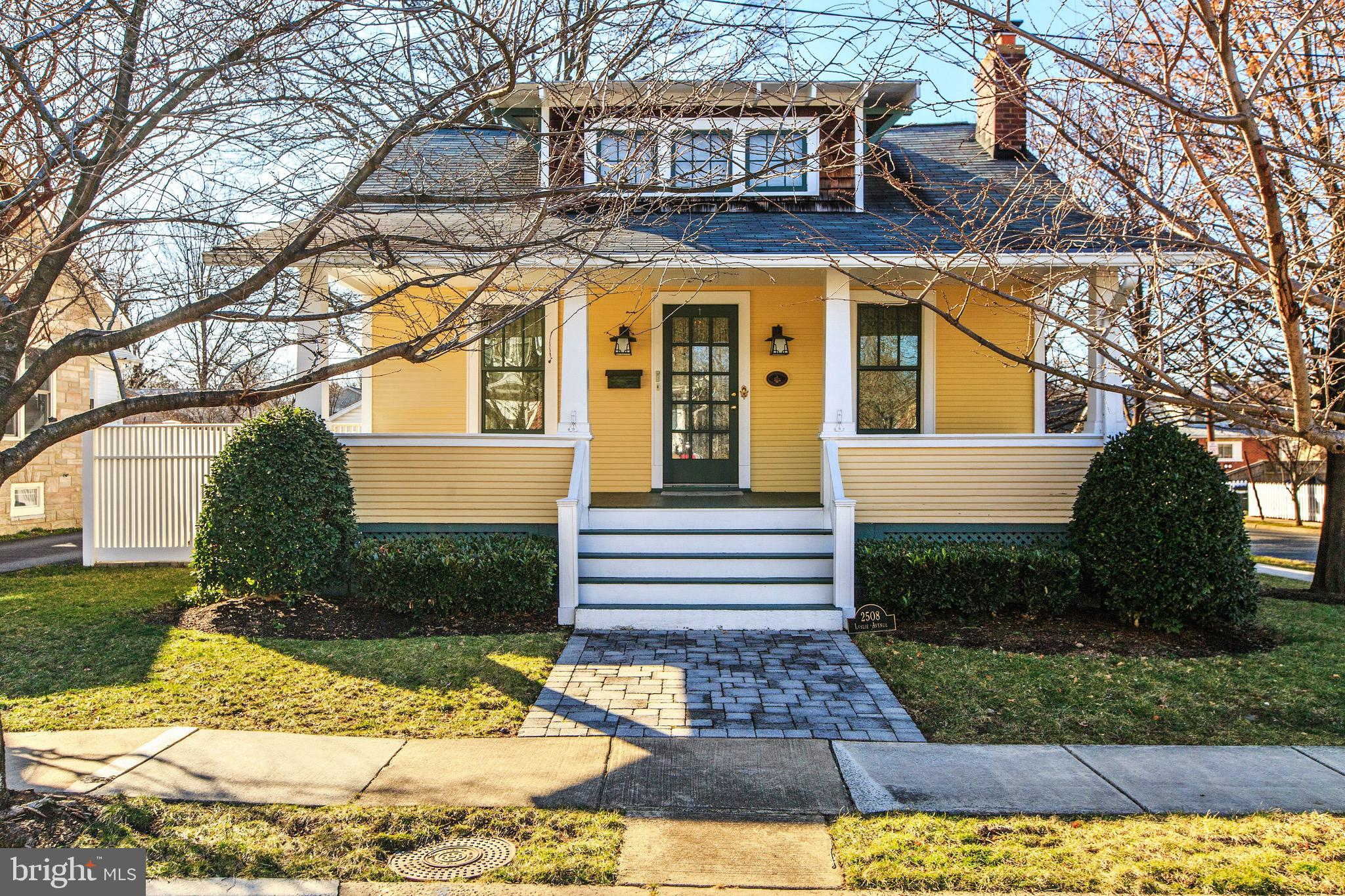 This charming Del Ray Bungalow offers inviting front porch and is situated on a gorgeous, treed corner lot, adding incredible shade and privacy. Located just blocks off The Avenue in the heart of Del Ray and short stroll to thriving Potomac Yards. Beautifully renovated from top to bottom in 2001 and oozing with charm. Custom woodwork through-out, gleaming hardwood floors, offering a rarely found main level master suite, with two full bathrooms and smaller second bedroom converted into a large maser closet. The wide open, yet cozy living room offers a wood burning fireplace and tranquil study. The separate dinging area has a small bump out and opens to kitchen maple cabinets with Plexiglas liner, granite counter tops and built-in breakfast bar. The beautifully hardscaped backyard offers for low maintenance. The French doors opening onto the beautiful paver patio from the studios indoor-outdoor kitchen makes for perfect outdoor entertaining. The wood deck off the kitchen is perfect for morning or evening dinning. Hard to find in Del Ray, oversized two car garages with addition workspace and storage, is a dream come true for most. The paver driveway offers not only convenient off-street parking for two cars, but is stunning to look at. The two-level studio leads to many possibilities. Home office perhaps, or add a full bath (plumbing added when built) and use as an in-law suite!