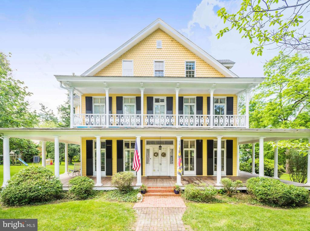 New Price!!  Come and see this Grand Renovated Victorian perfectly sited on a flat and private 1.42 acre corner lot is Historic Lutherville.  From the minute you pull up you can sense the rich history as it was originally built in 1860 as a summer home for the  Talbot family.  The large wrap around porch and patio make it wonderful for spring and summer entertaining.  In side you enter through thick double doors to a large foyer and you notice the high 9'+ ceilings and incredible moldings and gleaming hardwoods from the past.  This home boast large formals, a remodeled white kitchen with stone fireplace, granite, stainless steel appliance and cathedral ceilings.  The home has 6 bedrooms, 4.5 baths and an attic space great for storage.  The detached carriage house is wonderful for a home office, gym or extra space for the family.  It also has an over sized two car garage, circular drive way and so much more. Minutes to the Beltway and I-83 and Walking distance to Towson Hot Bagels and Moms Organic Market.  Desirable Baltimore County Schools.  Feels Like Roland Park but with County Taxes.  Must See This One!