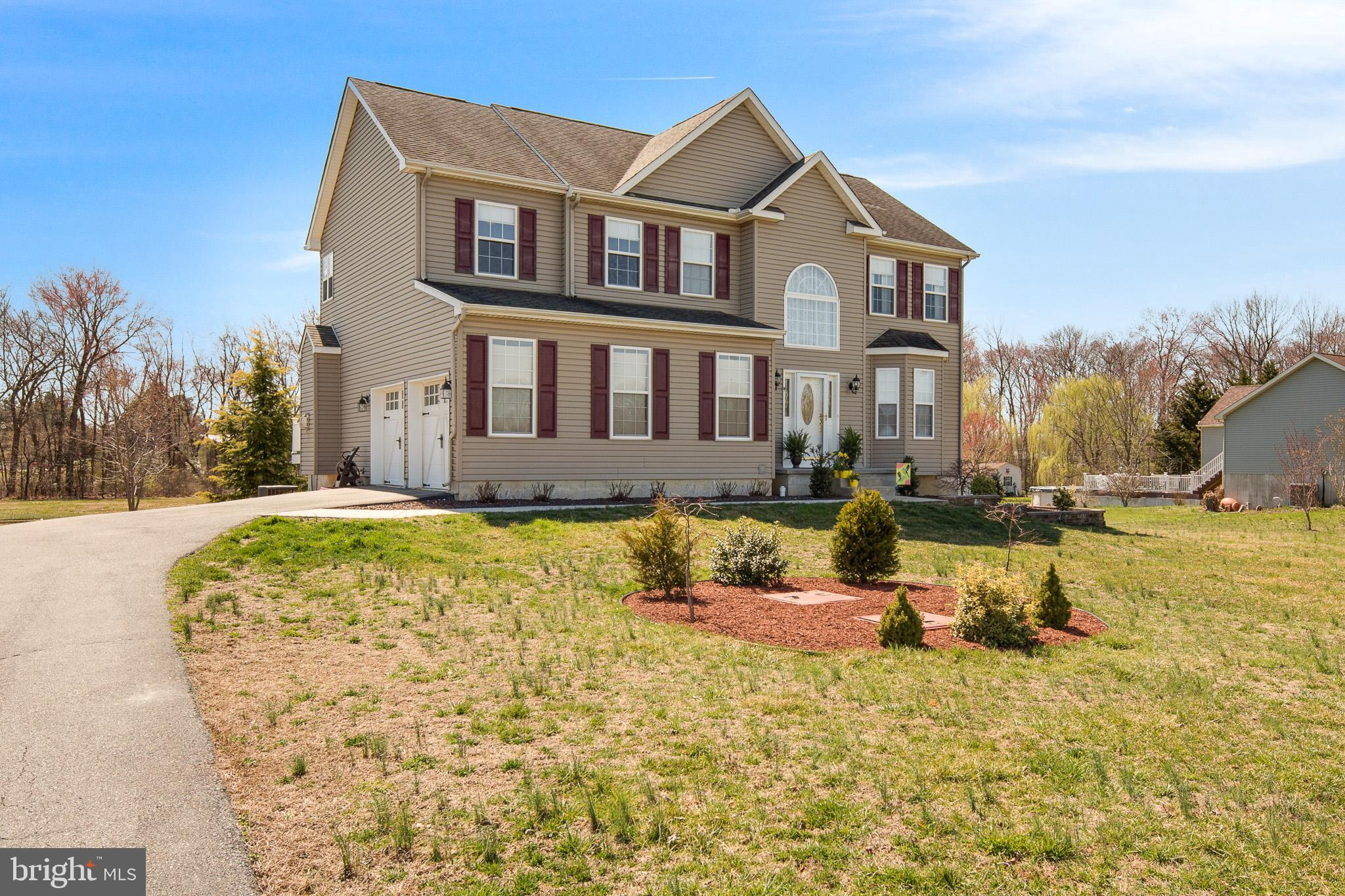 Welcome to 308 Christine Lane. This two story colonial is beautifully maintained with 2,550 sf of living space situated on 1.88 acres in the desirable sub-division of Claybourne. Entering the foyer, you will notice the beautiful hardwood flooring and stunning staircase.  There is a formal living room and dining room that flows into the kitchen. The kitchen is spacious with plenty of cabinets including an island and desk area. There is a large slider, which opens onto the spacious trex deck, with steps to the back yard.   The kitchen has an open view into the family room with a gas fireplace, large windows and a view of the deck and back yard.  Upstairs, the Master Bedroom is on the left. This room has a vaulted ceiling, ceiling fan with light and a large closet.  The Master Bath is roomy, with a large corner jetted soaking tub, separate tiled shower and a double-bowl vanity with storage. There are three additional bedrooms and a full bath with tile flooring, double bowl vanity and a tub/shower combination. A full, unfinished walk-out basement gives you plenty of opportunity to customize and make it your own.  Many opportunities for outdoor living. Outside amenities include a fire pit, shed with garage door entry and a small creek that runs behind the property.