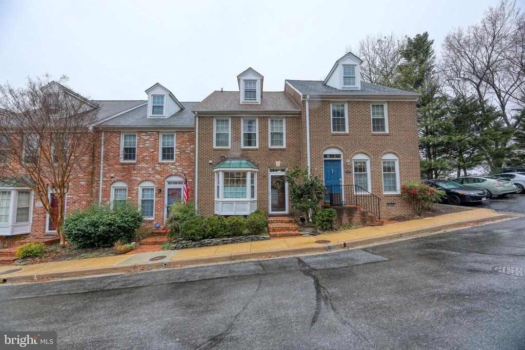 GREAT LOCATION! 3BR / 2.5BA Sun-filled brick Townhome quietly nestled behind the Masonic Temple in a sought-after neighborhood rarely on the market! Features: 3rd Level Loft, Hardwood Floors, Sep Dining Rm, Fireplace in Living Rm, French doors from Living Rm to Custom Deck. Easy walk to King St. Metro & charming Old Town. A commuter's dream!