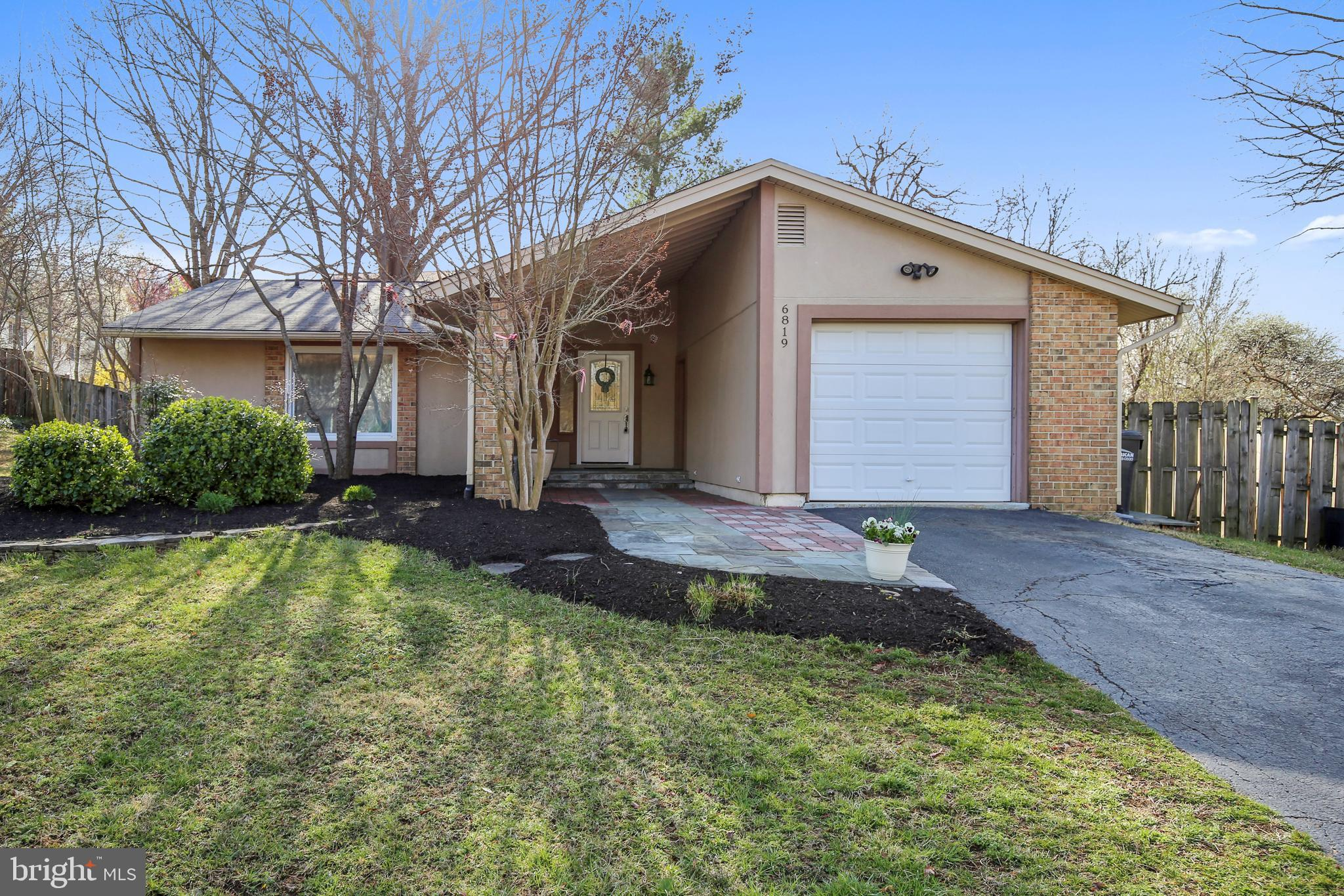 OPEN HOUSE ON SUNDAY, APRIL 7, FROM 1 TO 4 PM*******One level living at its best in freshly painted, light filled contemporary on large level lot.  Recent roof, bathroom and kitchen updates, wood floors, tile, carpeting.   Vaulted ceiling in living room and woodburning fireplace with stove insert.  Deck off the kitchen leads to level, fenced back yard.  Space for play, sports, pets, and gardening.  Built-ins in the second and third bedroom and a walk-in closet in the master bedroom.  The garage provides space for a car and additional storage.                               A wonderful spot to call home -- near Huntley Meadows, Wegman's, Fort Belvoir, and Kingstowne.