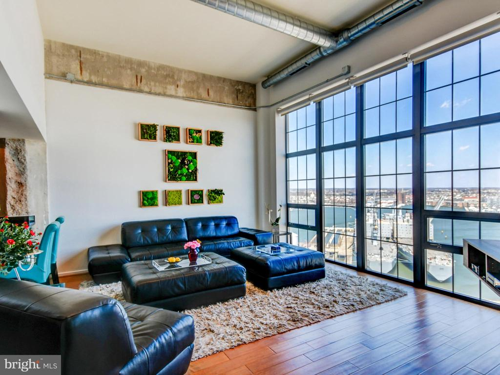 High ceilings, expansive views and floor-to-ceiling windows make this 1 bed / 1.5 bath condominium one of a kind!  Meticulously maintained, light-filled and high-end finishes like granite counters, stainless appliances and beautiful wood flooring.  Enjoy the impressive views of the Baltimore Harbor from your private balcony.  Full service, luxury condominium building in one of Baltimore's most popular neighborhoods.  Amenities that include 24/7 front desk staff and fitness center, Sky Lounge, secure parking and more!  Close to 95, Under Armour, shops, parks, entertainment and restaurants.