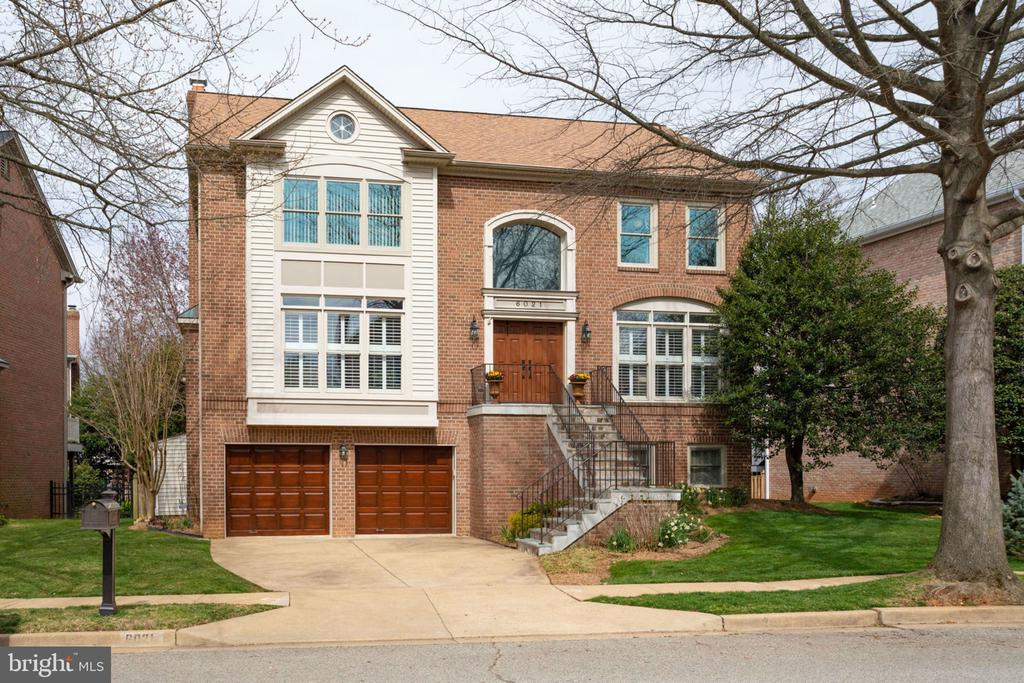 Spacious and bright! You'll fall in love with this home and it's open floor plan that includes a large eat-in kitchen. Hardwood floors throughout the main level, plantation shutters, and lots of living space. Finished walk out basement, with built in wet bar, cork flooring, and easy access to a two car garage. Enjoy spending time on the back deck, overlooking a private fenced in yard! Great location, nestled on a quiet cul-de-sac, quick access to Rt. 50, and minutes from Washington, D.C. . Yorktown High School pyramid. Don't miss this one!