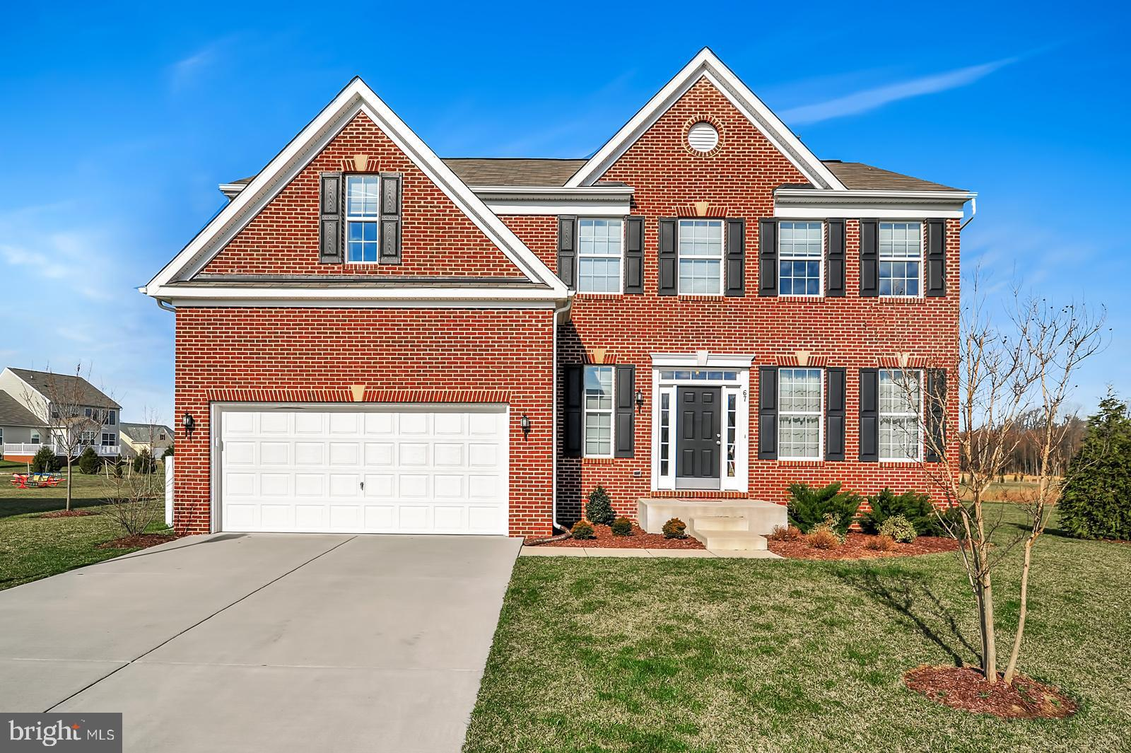 R-10899 No need to look for new construction - this beautiful brick colonial is only 3 years old and appointed with every upgrade imaginable! Located in the sought-after neighborhood of Reserve Chestnut Ridge in the Caesar Rodney School District, this 4 bedroom home has it all.  It features a gourmet kitchen with endless granite, stainless upgraded appliances, hand scraped wood flooring, and morning room addition.  The open plan from kitchen to family room makes the rear of this home the place to be.  The family room boasts a gas fireplace with stone backdrop and mantle.  The second floor includes the generous master bedroom with walk-in closet and luxury bath featuring an over-sized tiled shower and separate soaking tub.  The finished lower level is too good to be true with wet bar, massive family/game room, full bath, and additional office or media room.  This home is also situated on a premium cul-de-sac lot and is pond front!  Enjoy the water view from the wraparound deck or sit by the water side and fish in the stocked pond.  Call for additional information.