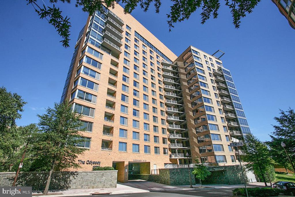 Move-in ready corner unit at the highly desired Odyssey Condominium! Private balcony, large windows with great natural light, Elfa closets. New hardwood floors and fresh paint. Tons of great building amenities including rooftop pool, fitness center & concierge. Prime location - Walkable to shops, restaurants, Metro & more!