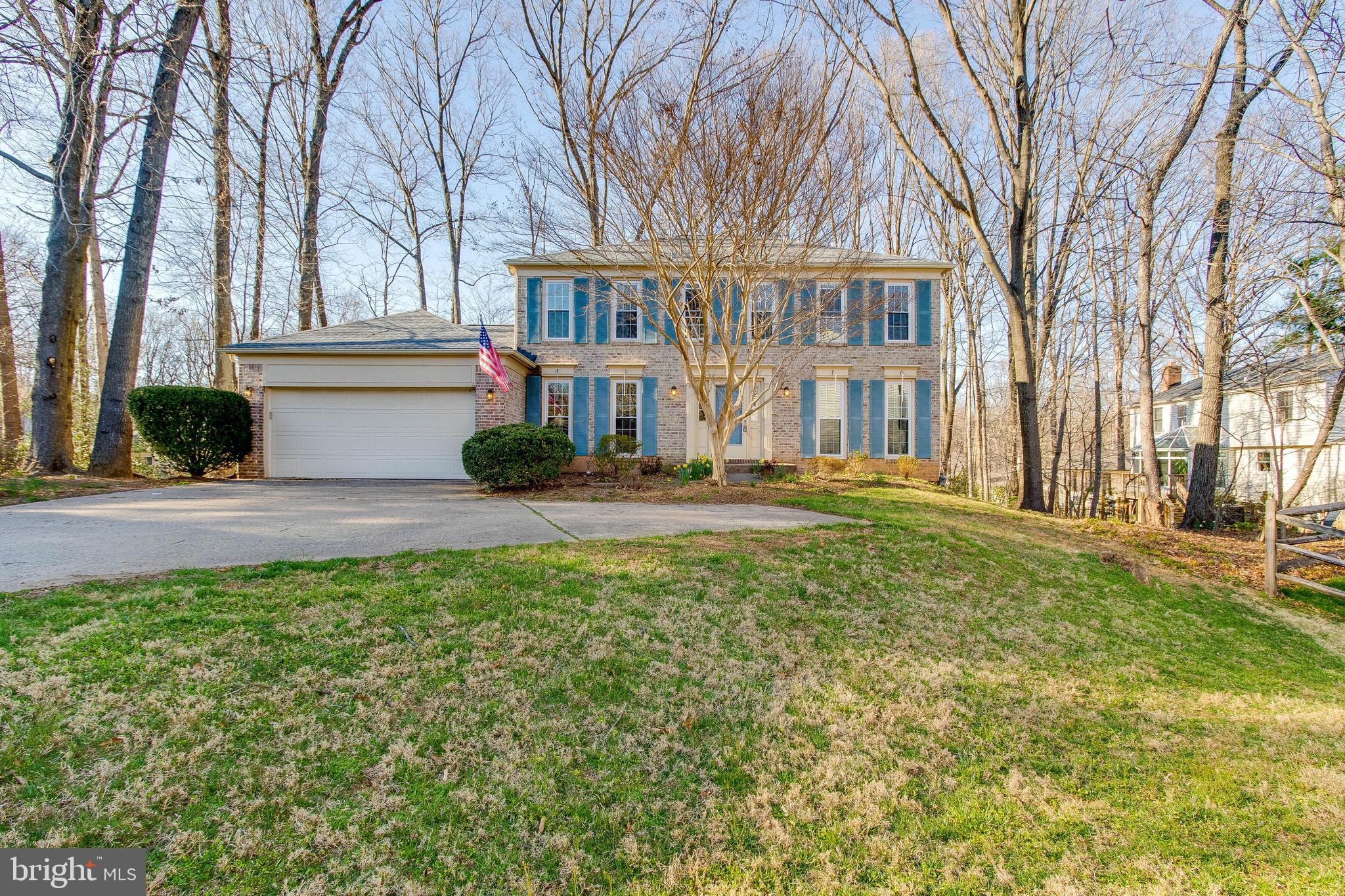Wonderful brick front colonial on over a one-third acre lot in prestigious Burke Centre. This home features a spacious kitchen with plenty of counter and cabinet space, stainless steel appliances and more. Separate dining room and large family room with brick fireplace, built-ins and access to your screened in porch and deck. The main level has a master bedroom with full bath, large closet and french doors. Outstanding walk-out lower level with rec room, large laundry area and plenty of extra space to make your own. This home backs to trees for you to enjoy the outdoors any time of the year. This home is also handicap accessible if needed.This home is a must see!