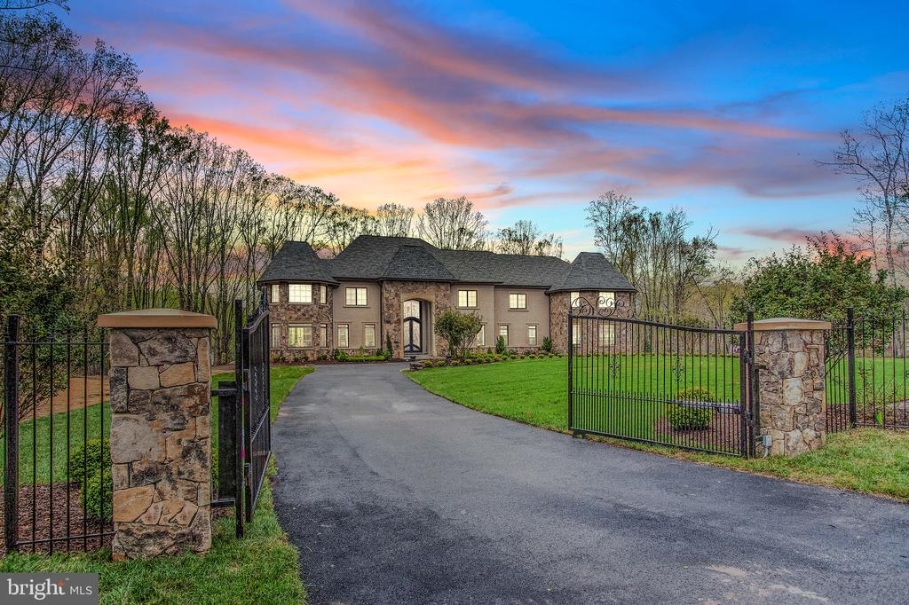 "Fabulously set on nearly 3 gated acres in McLean's Peacock Station neighborhood rests this like-new mansion offering top-quality construction & materials. With over 13,000 finished square feet on the three elevator- serviced levels, our features include: dramatic open floor-plan on the main level, massive main kitchen with seperate caterer's kitchen, sumptuous owner's suite with ""must-see"" extensively built-out closets and luxury bath, a true entertainer's lower-level with large bar, dry & steam saunas, cinema, game rooms and more. Garage parking with 4-bays and an amazing expansive deck overlooking the rear grounds large enough for a potential pool."