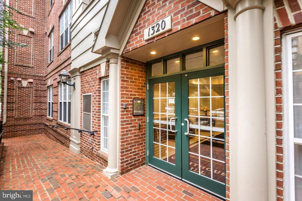 Rarely available 2 story condo just steps to Courthouse metro with 2 garage spaces-This beautiful condo features brand new wood floors/stainless kitchen/liv rm w/gas FP/balcony/W/D in unit*Master BR on 2nd lvl w/ spacious walk-in closet*Luxury master bath w/soaking tub and sep shower*Roof 2015*HVAC 2018*HWH 2015*Condo amenities include pool/gym/onsite mgmt/water*Walk to shops/movie&more*Pet friendly*