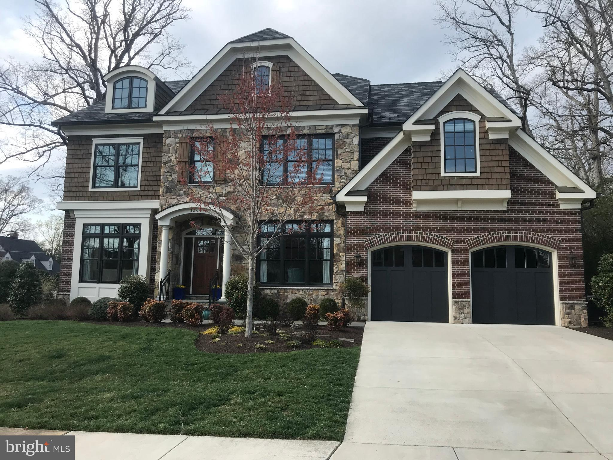 """There is a rare find in every community and this is your opportunity to own this """"stand out"""" custom upgraded home in one of our area's premier communities. Finishing touches on this gorgeous contemporary colonial were completed in early 2014, and the results reveal a truly spectacular urban estate. This home is perfectly sited on a premium corner lot offering a beautiful front elevation view and a good amount of ~romp and play~ space. There are four fully finished levels plus a covered pavilion and stone deck offering marvelous outdoor entertainment space. The home's main level has ten-foot ceilings and has hardwood flooring throughout, as well as crown molding. All other levels have nine-foot ceilings. The open floor plan offers a sun lit Living and Dining room on the Main Level as well as a Library, and a lovely Family Room w/fireplace.  The Family Room also provides  access to the covered pavilion and is   open to the magnificent gourmet Kitchen which  features expansive granite counter tops and high-end appliances to include a six-burner gas Wolf range. An over-sized two-level center island with beautiful bevel-edge granite is both a working station and pull-up eating counter, easily seating six.   Custom cabinetry and panel-front appliances add tremendous storage. Two Kitchen Aid refrigerator drawers are nice bonuses. A window-surround Breakfast room adjoins the spectacular Kitchen and both rooms have custom grass cloth wall paper. Beautiful custom valances and blinds adorn the Breakfast Room windows. The Butler's Pantry has a wine cooler, wet bar and Miele coffee bar. A Half Bath is just steps from the Kitchen. The Mud Room is adjacent to the Kitchen and offers tremendous extra storage.  The over-sized two-car Garage is entered from the Mud Room. The Bedroom level features a private Master Suite with a coffered ceiling, two walk-in closets, a luxurious ensuite bath with slipper tub, double sink vanity and over-sized shower. The sitting room is a private space """