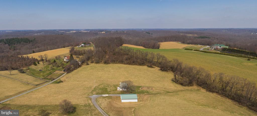 Beautiful 17.5 acre property offering the best of both worlds - open pastoral views plus beautiful woods. Cute cape with original stone foundation has loads of potential. Large metal pole barn with electric provides space for farm equipment and vehicles or could be converted to a barn for animals. Minutes to the NCR trail and an easy commute via I-83. Plus Hereford Zone schools! The perfect place to make your own on a spectacular piece of property. .33 acre tax id# 04060608030381 included. NEEDS REHAB - SOLD AS IS! NO FHA/VA. PLEASE DO NOT WALK PROPERTY WITHOUT SHOWING.
