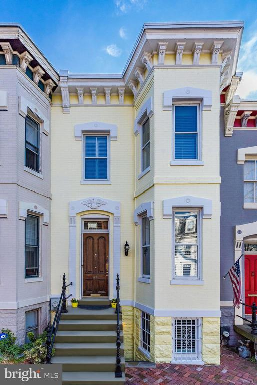 Historical charm meets modern luxury at 1231 30th St NW, located just seconds from the shops and restaurants of M Street in one direction, and Rose Park in the other. Not only is the location ideal, but the private off-street parking spot and wonderful neighborhood feeling make this house a home.  Recently renovated top to bottom by BOWA Construction, the home features a tiled entryway which soon gives way to refinished, antique wooden floors and 10-foot ceilings. The sunlit kitchen features natural quartzite countertops and island, all new appliances and a gas log fireplace as a beautiful focal point of the kitchen. The stairwell and exposed brick wall are bathed in sunlight from the full skylight on top of the stairs.  The master bathroom similarly contains a suite of high-end fixtures - all of them top-shelf Waterworks products - as well as a marble tile shower surround, hammered chrome sink, and heated floors beneath a dazzling bathroom skylight. Each of the three fireplaces has been converted to a gas log system, and plantation shutters have been added to all of the windows. Additional upgrades include  cutting-edge HVAC and security systems, a  rewired electric panel, a tankless water heater, and a new roof. Nothing was overlooked in the renovation of this beautiful home.  The main and lower levels  are each equipped with an outdoor porch and deck  area providing quiet and privacy from the excitement of Georgetown.