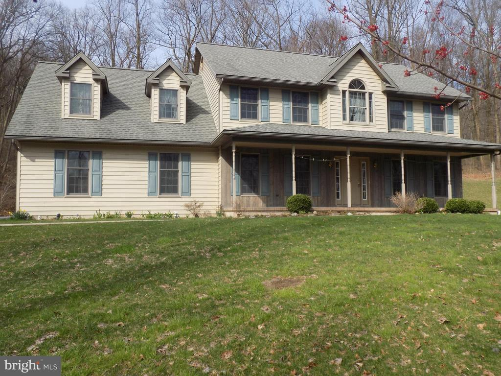 Country 2 story home on 10 acres. 4 Bedroom, 2 1/2 baths with a bonus room on top of the garage. Home has large kitchen with a great view. Also first floor laundry, 2 outbuildings and wood furnace. Must see!!