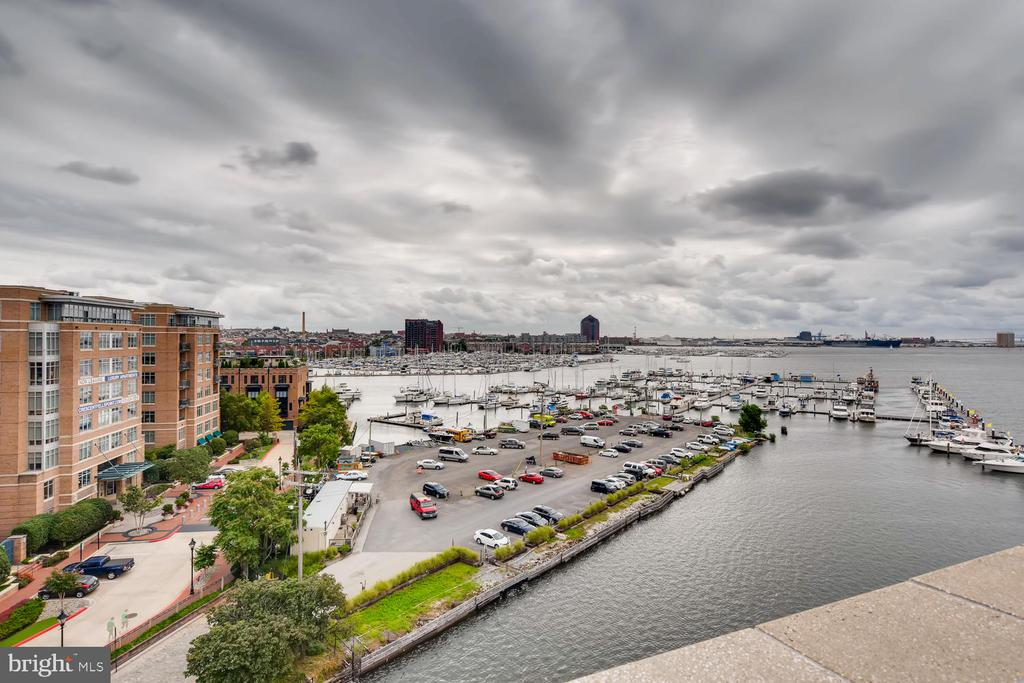 Very Motivated Seller!  Price Improvement and first 6 Months HOA dues free (paid by seller - great incentive)!!  Come check out the awesome water views from the penthouse level in this beautiful  2 story condo in historic Henderson's Wharf / Fell's Point area. This condo is a spacious 2163 sq ft, 2 bedroom, 2.5 bath,  with balcony that spans the width of the condo's 2nd level and overlooks the harbor.Kitchen has granite / stainless, hardwoods on main level, walk in closets in bedrooms. Walk to shopping / restaurants...best location in Fells!!!