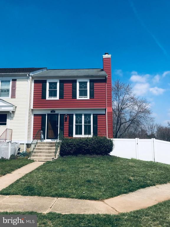 END OF GROUP SPACIOUS TOWNHOME WITH REAR PRIVACY FENCE. GREAT LOCATION, CLOSE TO I695, NICE KITCHEN WITH STAINLESS STEEL REFRIGERATOR, SLIDING GLASS DOORS TO DECK IN FIRST FLOOR AND SLIDING GLASS DOOR TO BACK YARD IN BASEMENT.