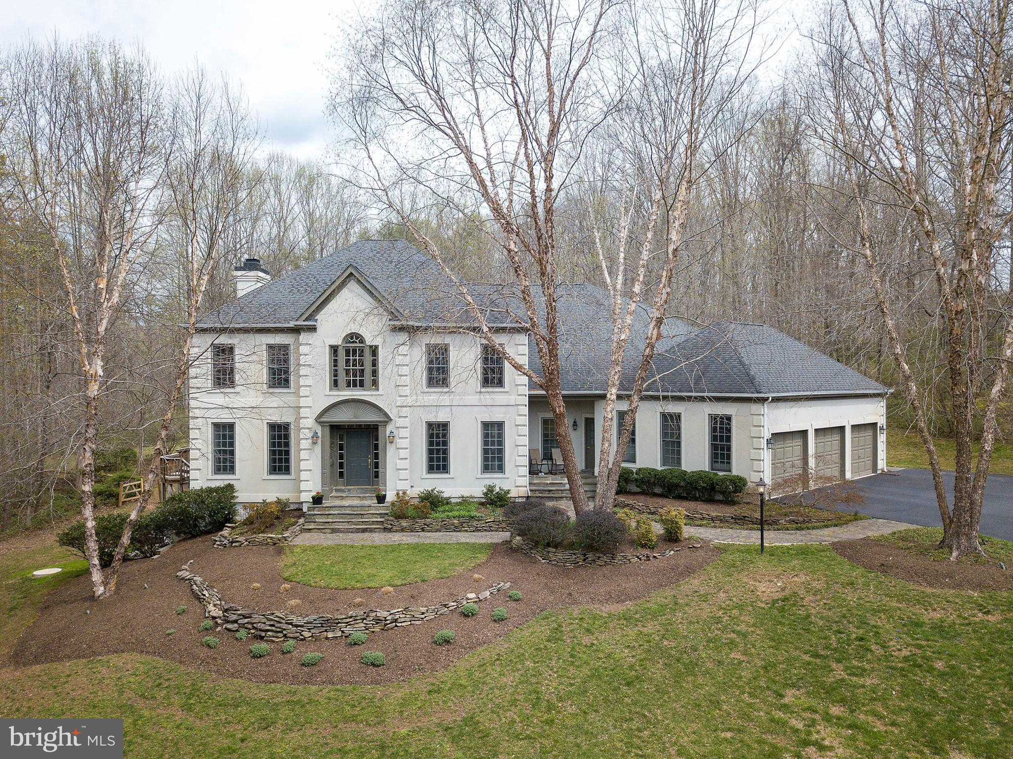 OPEN SUNDAY 4/14 FROM 1-4**This custom designed and built Transitional Colonial is located in THE ENGLISH HILLS one of Fairfax Station~s finest communities. Step inside and you will be impressed by the open exciting floor plan design. Enhanced with architectural details, this home features three finished levels tall ceilings, gas fireplace with custom built-ins, generator, two zone HVAC systems, designer d~cor, numerous recessed lighting and gleaming hardwood flooring.The main level includes a two story open foyer, spacious chef~s kitchen with granite counter tops, natural cherry cabinets, built in desk, two wall ovens, five burner gas cooktop, refrigerator with icemaker, dishwasher, a large sun filled breakfast room with boxed bay window seat, family room with french doors, palladium windows, gas fireplace with built- ins, main level powder room, formal living room, lovely gracious dining room and a main level guest bedroom/den with full bath.Just a few steps from the kitchen area you will find an additional front entrance with back foyer, laundry room and second staircase up to bedroom level.  Up the staircase to the fabulous bedroom level where you can relax in the open loft/bedroom area The master suite with spacious walk in closet, designer bath with two vanities, large glass tile shower and soaking  Jacuzzi  tub and skylight. There are two additional spacious bedrooms each with their own full bath. No stone has been left un-turned to compete this fabulous home, the lower level has ample space for all, a game room, recreation room, and party bar with built in  cabinets plus an spacious additional bedroom and  full bath and HUGE storage area. This extraordinary private five acre estate features circular driveway allowing for easy entrance and exit to home. Extensive landscaping, stone walkways, stone retaining walls,  mature trees and abundant wildlife. This home is perfectly sited with wooded views from every vantage point. Enjoy peaceful evenings and cool afternoons on your spacious multi- level deck.  You can vacation at home in your in-ground heated pool complete with waterfall and hot tub/spa.Welcome HOME!