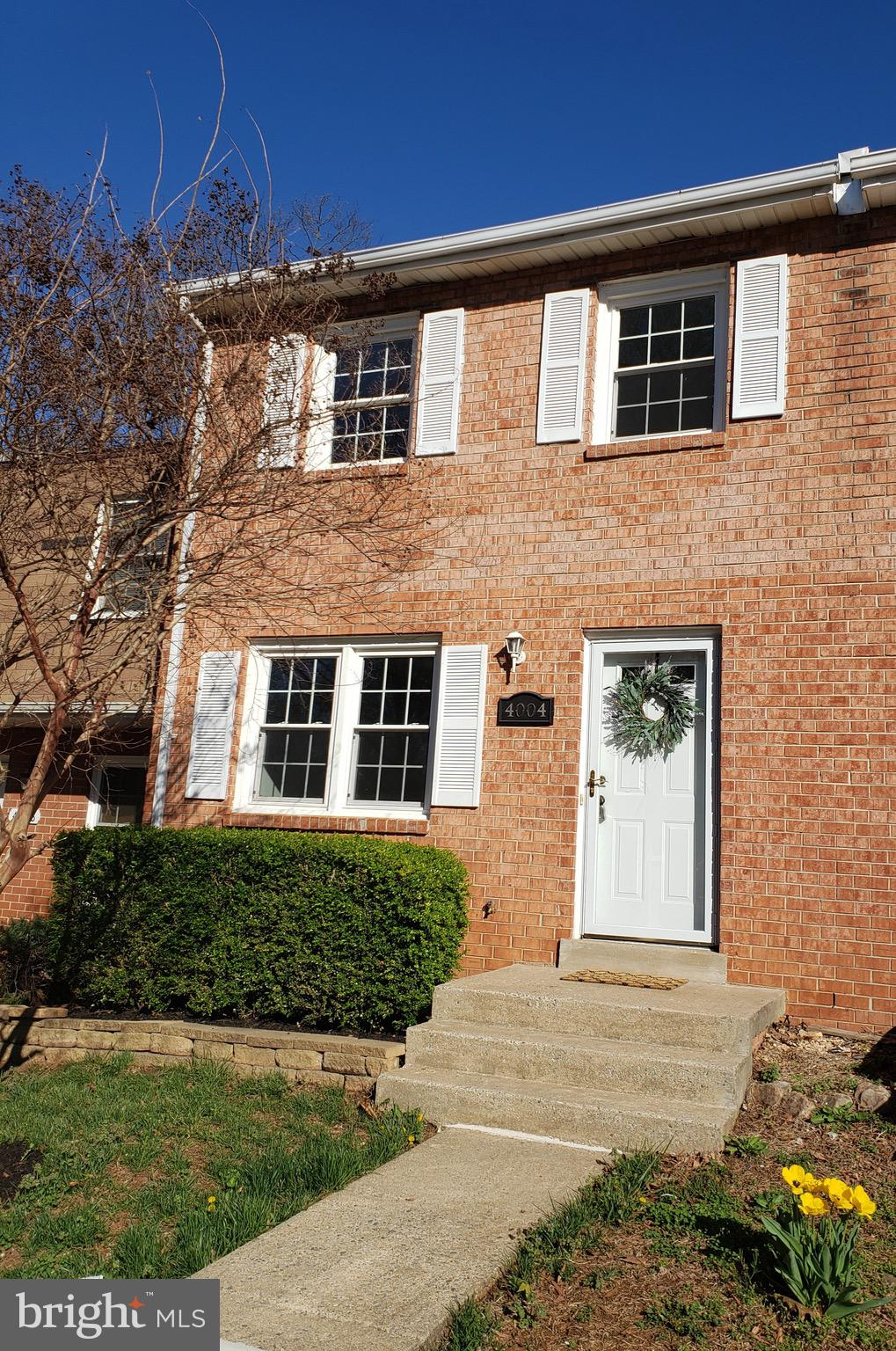 Welcome to comfortable living and ultra convenience this stunning property offers. Spacious floorplan with over 1200 sqft. Newly refinished kitchen with custom tiling includes granite. Separate dining room steps out to enchanting patio overlooking lush trees.Huge Owners retreat with loads of closet space. Two large additional bedrooms and bath complete the upper level. Close to shopping, dining, entertainment.Enjoy quick access to major commuter rtes and slug line. Well maintained home with new roof and new carpet. See it before it's gone!
