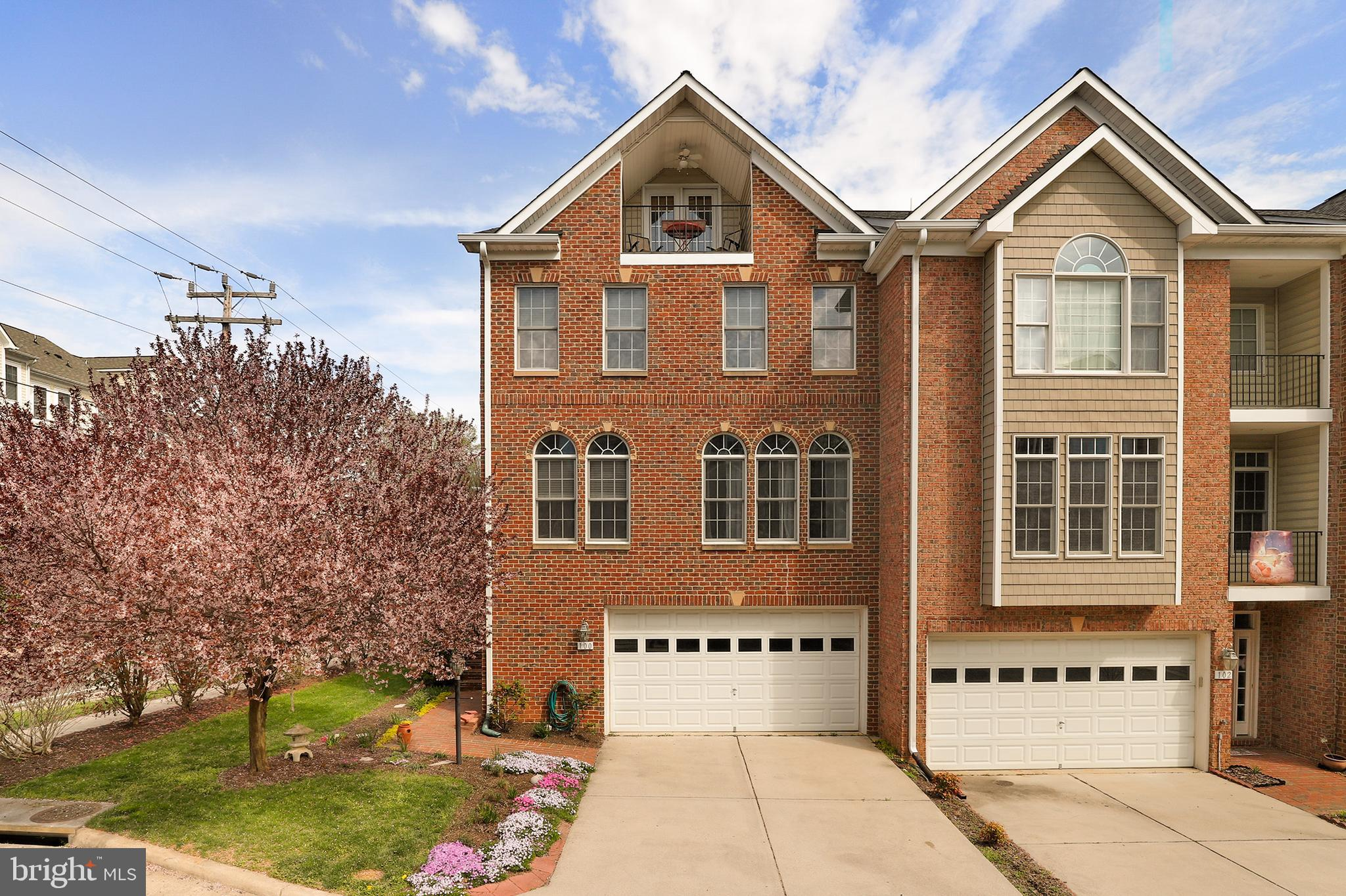 Immaculate 4 Level end unit luxury townhome in historic Occoquan! The oversized transom and palladian windows invite abundant natural light on all levels!  Attention to detail can be seen in every room to include tray and vaulted ceilings, hardwood floors throughout, remodeled bathrooms and recessed lights.  A chef's kitchen boasts stainless appliances, custom backsplash and easy access to deck with a retractable awning- perfect for lounging or dining al fresco!  Main level has office or potential legal 4th bedroom!  Luxurious master offers well-organized walk-in closet & bathroom with tub & dual vanities.  Upper level loft features a darling & private veranda and full bath. Finished recreation room has walk-out to the covered patio and rear yard. Updates include~ NEW A/C units & evaporator, MBA frameless glass shower & quartz countertop, front entry door/sidelites/storm door. This enclave of homes DOES NOT have HOA.   Simply Impressive!