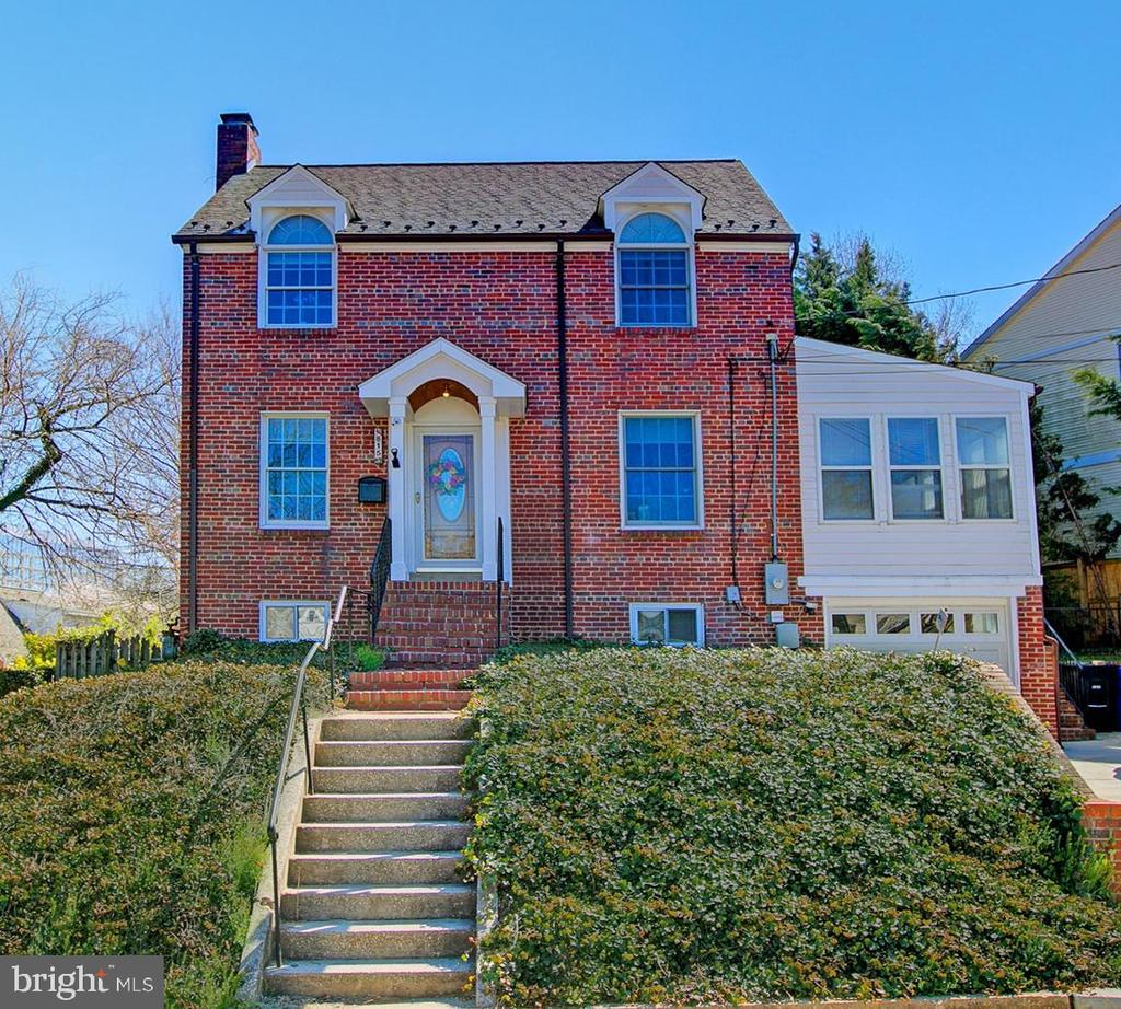 Light, bright 3 level brick Colonial on quiet street less than half mile to Ballston Metro and a block  from bike trail and parks.  Updated kitchen and   baths,  gleaming hardwood floors on 2 levels,  kitchen and sunroom with walls of windows opening onto large deck  --plus garage and driveway with       paved parking for 3 cars.   A MUST SEE!!