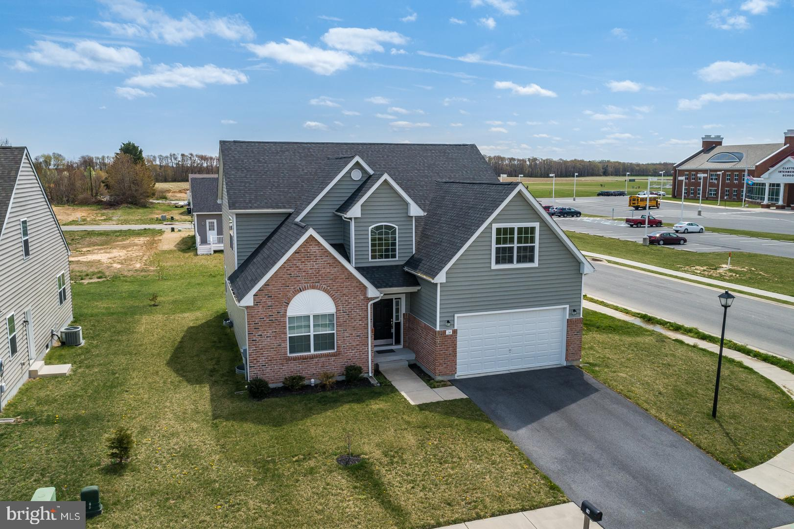 Available for immediate occupancy!  This 2 year like new home was formerly built to be the model home and barely showing signs of being lived in. Largest home in the neighborhood at over 3000 square feet because of the the finished 20x14 bonus room over the garage not included in assessor sqft.  Open floor plan concept allowing views across the living, dining, and kitchen areas.  First floor impressive Master Bedroom with tray ceilings, huge 15x11 Master Bath (soaking tub, tiled shower w/glass door, double bowl his/hers vanity), and a huge 13x8 Walk In Closet!  Office or 5th bedroom (does have closet) also located on the first floor.  Grand views from the catwalk over the open downstairs space.  Upstairs hosts 3 more great sized bedrooms, open sitting area, and the nearly 300 sq ft bonus room.  Unfinished basement with egress window could easily be finished.  Home features also includes upgraded brick veneer, attached 2 car garage, maintenance free deck off the dining area, premium corner lot, and more.  Why wait for new construction when this home is eligible for quick delivery!  Located in 3 peat State Football Champs Smyrna School District close to DE Beaches and RT 1 for easy commuting!
