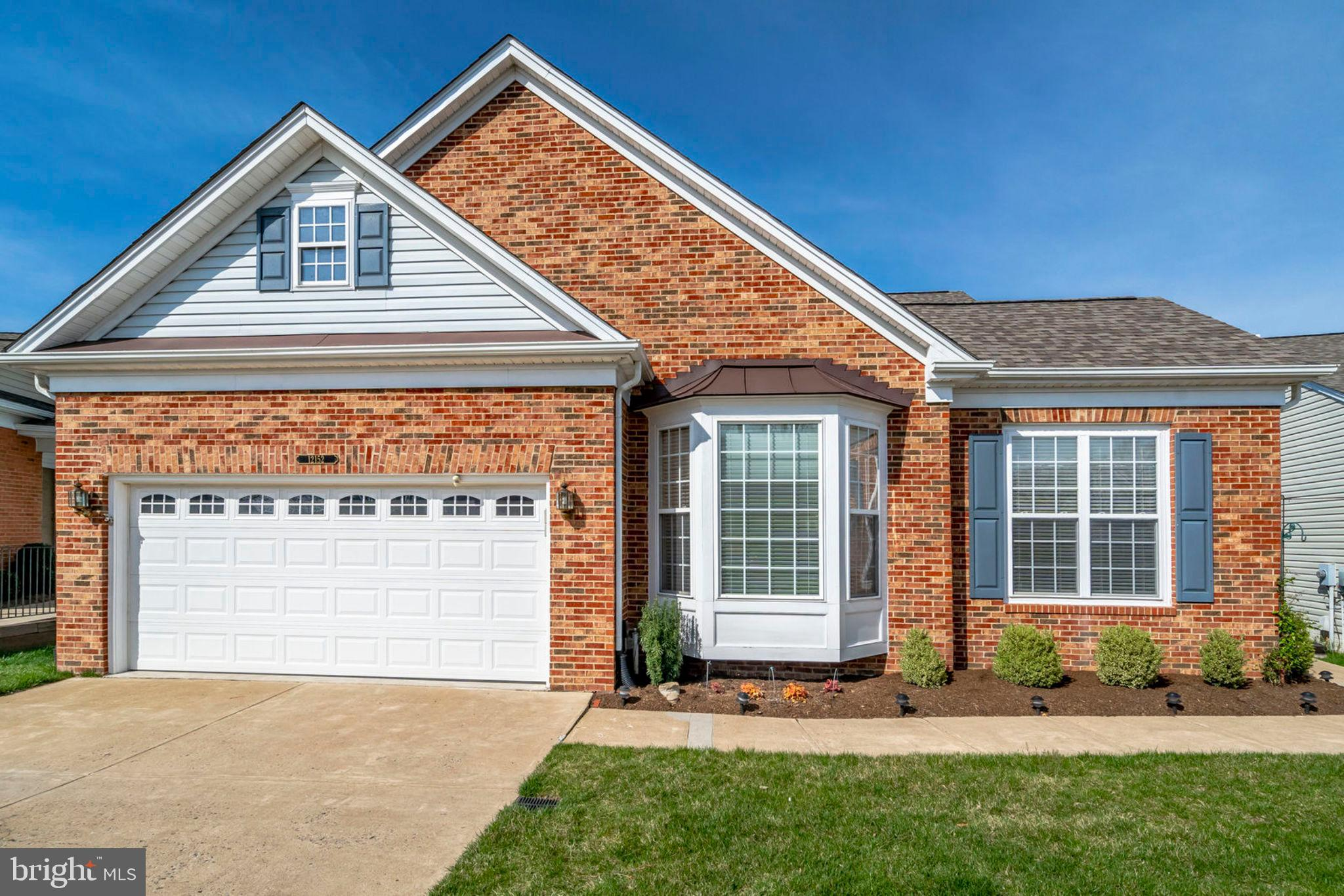 Immaculately kept brick front colonial in wonderful active adult community of River Ridge!  Three bedrooms and three full baths!  Study with french doors!  Upgraded hardwoods with no thresholds in living, dining and rec room.  Fireplace!  New carpet in study and all bedrooms!  Tray ceiling in master bedroom!  Gorgeous moldings and wainscoting,  Remote blinds in family room and master. Loads of cabinets and counter space in kitchen.  Corian counters!  Breakfast counter!  Enormous fully finished, walk out lower level features bedroom, full bath, large storage room and workshop!  Just in case that's not enough, there's a screened in porch, deck, and brick patio!  Just perfect