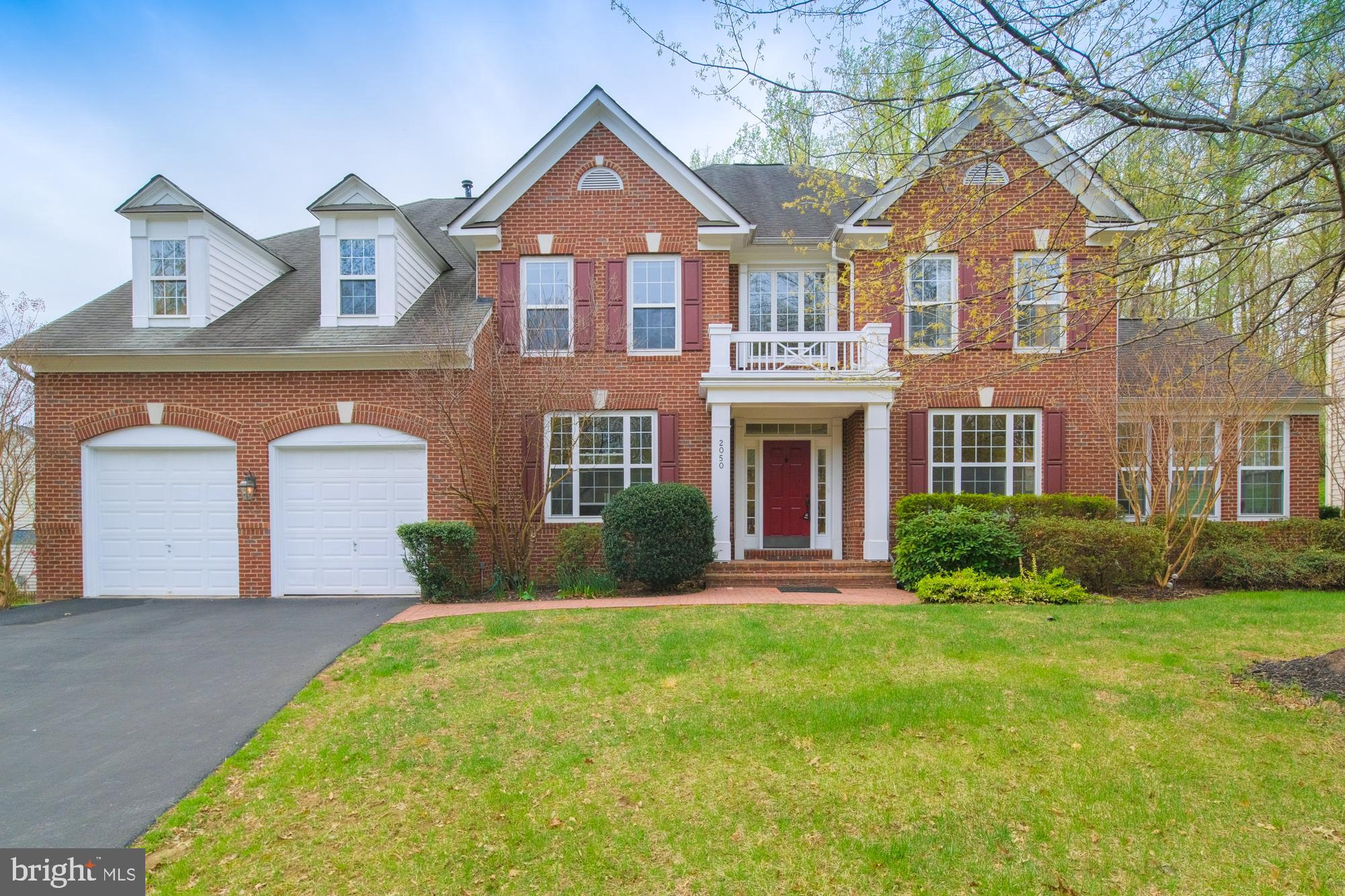 Beautiful brick front 4BR/4.5BA home in Powells Landing. Award winning Newport model over 5400 sq ft, $80k in upgrds. Hardwood floors in  Living Room, Dining Room, Kitchen and Study. Large Kitchen offers Granite Counters, Double Ovens, Built-in Microwave, Wine Rack, Breakfast Bar. Sunroom with Ceramic Tile. Sunken FR with Gas Fireplace & window wall. Huge MBR/Sitting Room with Gas Fireplace, Soaking Tub and  Walk-in Closet. Finished Walk-out Basement with a large Bonus Room that can be used as a Exercise Room, Theater Room or a Bedroom.