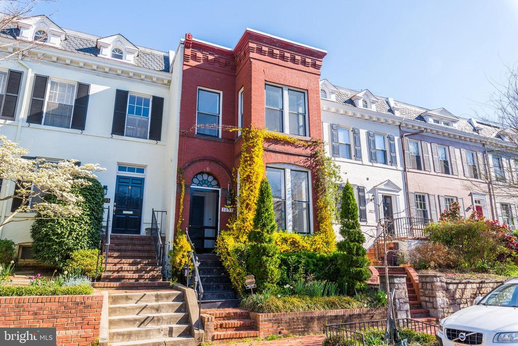 Fantastic East Village three bedroom and three bath row house with large three tiered terrace. Spanning over 2,100 SF (est), this three level home is located on a highly sought street and has beautiful hardwood floors, a fireplace, and a skylight. The first level features a foyer and a sunlit living room, formal dining room, and an updated kitchen with granite counters. The second floor includes a master suite with a walk in closet and mosaic shower and claw foot tub, a second bedroom and a full bath. Lastly, the lower level has a third bedroom/ recreation room and a full bath. A beautiful three tiered flagstone rear terrace completes this home.