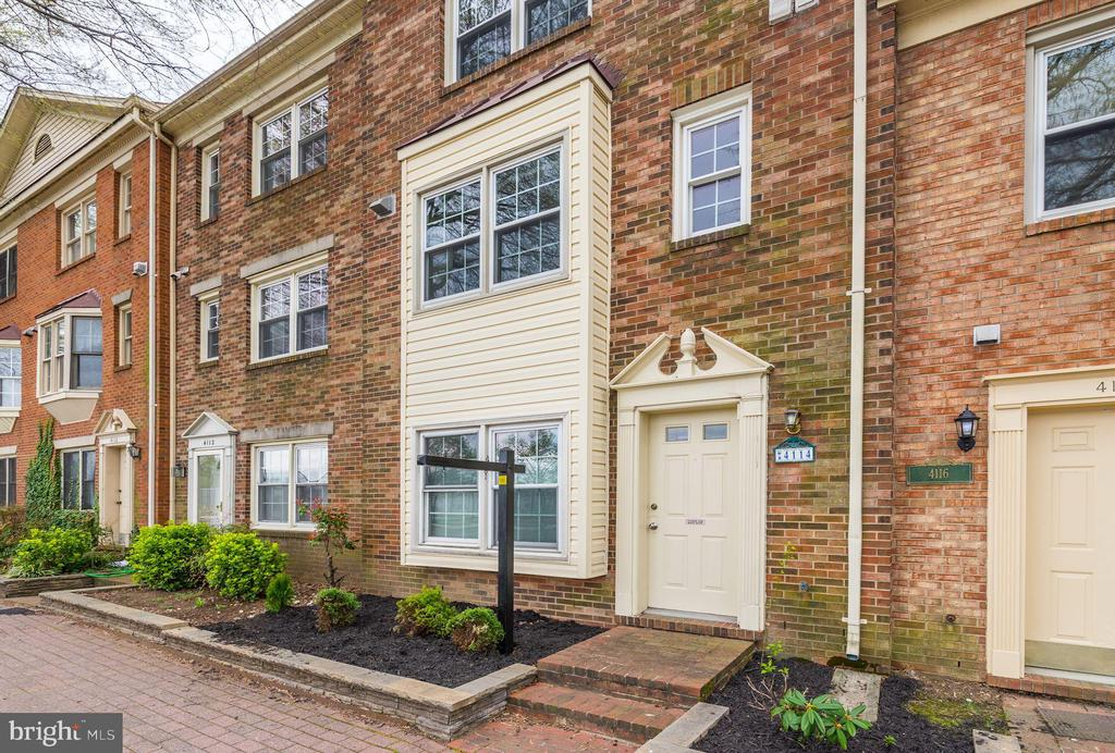 Welcome home to this spacious, updated, four-level townhome in the heart of Ballston.  Dual entry foyer allows entry access from private rear parking area.  Featuring four generously sized bedrooms and four and a half baths, this home provides spacious living a mere two blocks from the Ballston Metro and four blocks to the bustling new Ballston Quarter shopping and dining district. Numerous upgrades throughout including new granite counters, kitchen sink, and faucet (2019), New roof, siding, loft level carpet and washer and dryer (2018), renovated master bath and secondary bath (2016), young windows throughout (2014-2018), conversion of entry level half bath to full bath (2014), and more.  Smart and functional layout offers a full bath for each bedroom and main living level laundry room.  Attached one-car garage plus surface parking space #8.