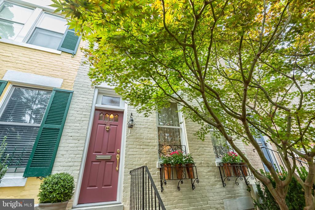 This Federal townhouse in Georgetown's West Village seamlessly unites historic appeal and comfortable elegance throughout all three levels. The turn-key property has been expanded and renovated including a newly installed gas fireplace, added staircase, Pella Architect Series windows, fully finished basement and a separate sunroom with deck access. Additional features include an open layout, hardwood floors, stainless steel appliances, two skylights, exposed brick and plentiful storage. The lower level family room leads out to a generously proportioned rear garden, seamlessly combining indoor and outdoor entertaining spaces. A convenient off-street parking space is available for lease. 3310 Dent Place NW is conveniently located one block from Volta Park and just minutes from Georgetown's many esteems shopping and dining venues.