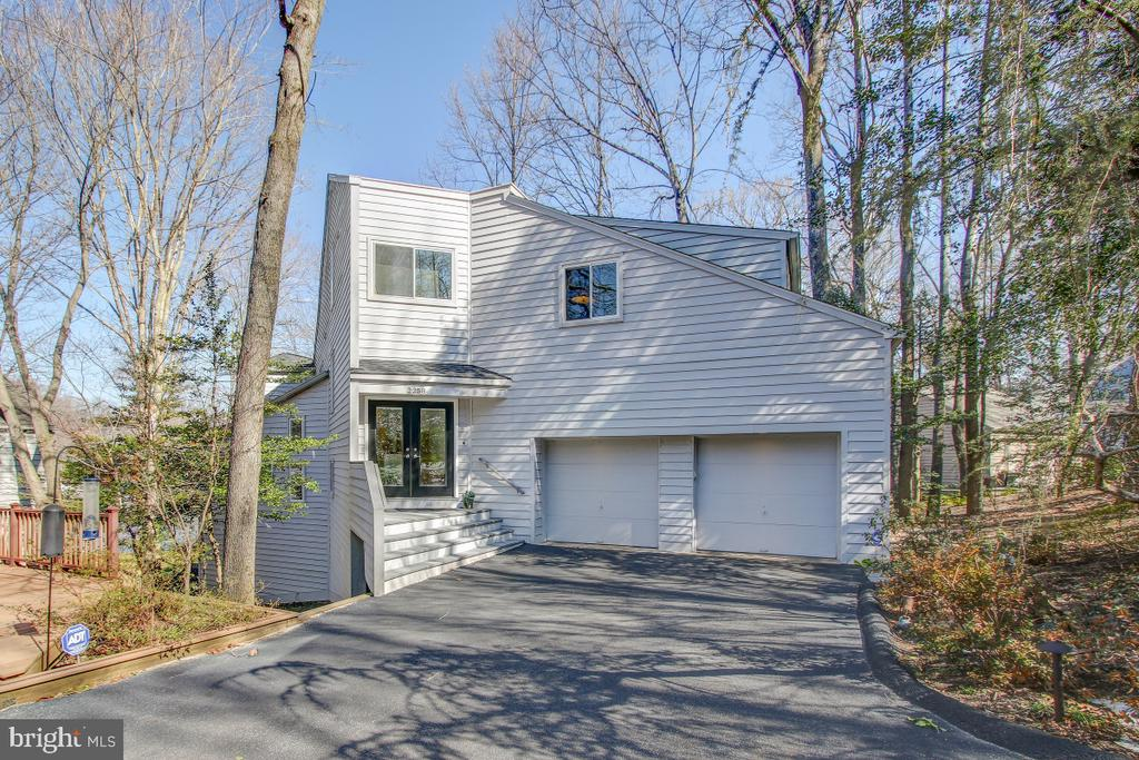 Exceptional contemporary on a stunning waterfront lot! Here you have the wonderful combination of an interesting house and terrific waterfront.  Gorgeous sunset views await you! The interior is full of light and offers spectacular views from every level! The floor plan lends itself to accommodating your lifestyle.  An award winning addition added space, function, and broader views.  Main level includes vaulted ceilings, skylights, gourmet Kitchen, LR, DR, FR, Sunroom, hardwood floors! Master Suite includes beautiful Bath, great closet space, an office, a Fireplace, and a balcony overlooking the lake! Two upper levels offer a loft, three Bedrooms, and a full Bath! The lower level features a large Rec Room, generous Exercise Room, a full Bath, and plenty of Storage.  It begins and ends with the flat lot, dock, pontoon boat, and Lake access.  This is the lifestyle that can be yours-relax and get away from life's stresses, yet be just minutes from all that makes Reston convenient-Metro, schools, Reston Town Center.  Come to see-come back to stay!