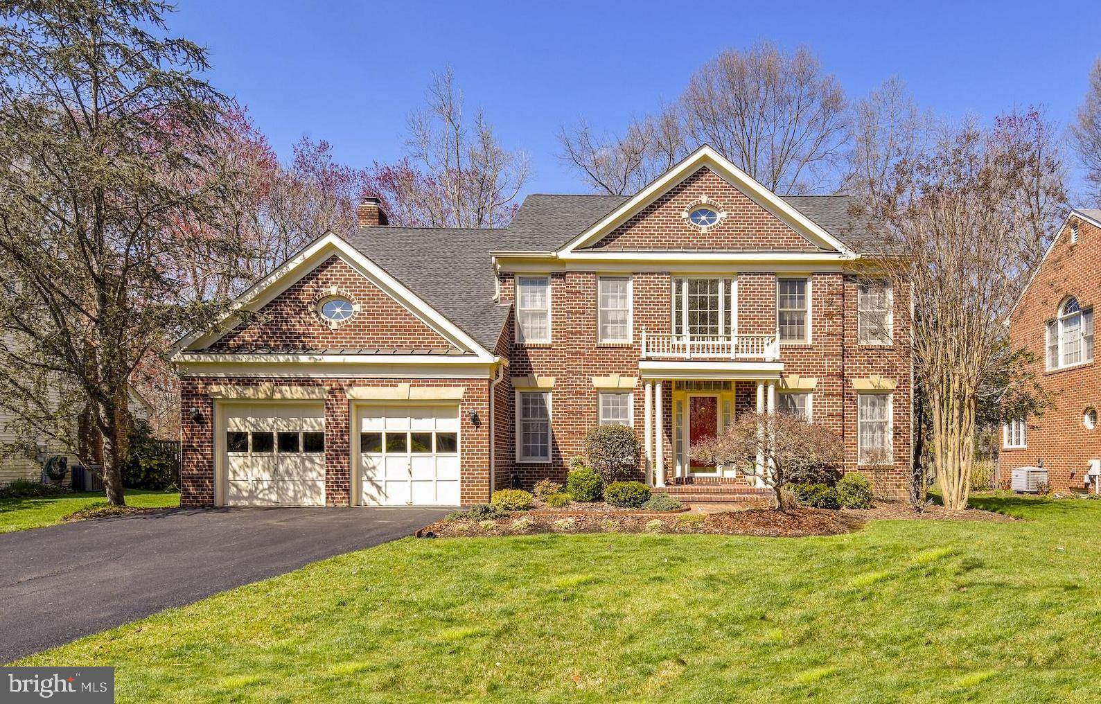 This stately brick front Colonial has been thoughtfully maintained and features many attractive renovations.  Recent updates were carefully completed with premium materials by experienced professionals.  A cedar-edged brick walkway leads to the columned front porch with new portico and railings.  Both formal and casual spaces for entertaining are found on the main level where an open concept kitchen, family room and adjacent sunroom are the heart of this home - each space contributing a particular ambiance.  The completely renovated kitchen is complemented by a breakfast room beaming with light from the bay window.  Highlights of the refreshed kitchen include granite counters, Travertine backsplash, pendant and chandelier lighting fixtures, premium porcelain floors, and a granite bar with glass-front cabinets.  The kitchen steps down into the cozy family room with a wood-burning fireplace and leads to the adjacent sunroom. Vaulted ceilings and a Palladian window create an airy, serene space that overlooks the landscaped backyard with a perfect view of the sunset from the large deck.  On the upper level, double doors lead to a spacious master suite with vaulted ceilings where light pours in from double skylights.  A charming sitting area, two large walk-in closets, double vanities with new lighting fixtures, a jacuzzi tub, and an expanded tile shower complete this suite.  There is no shortage of storage space at 8203 Mack St.  The home offers many large closets, a finished basement with two large rooms for stowing items, and a sizable two car garage.