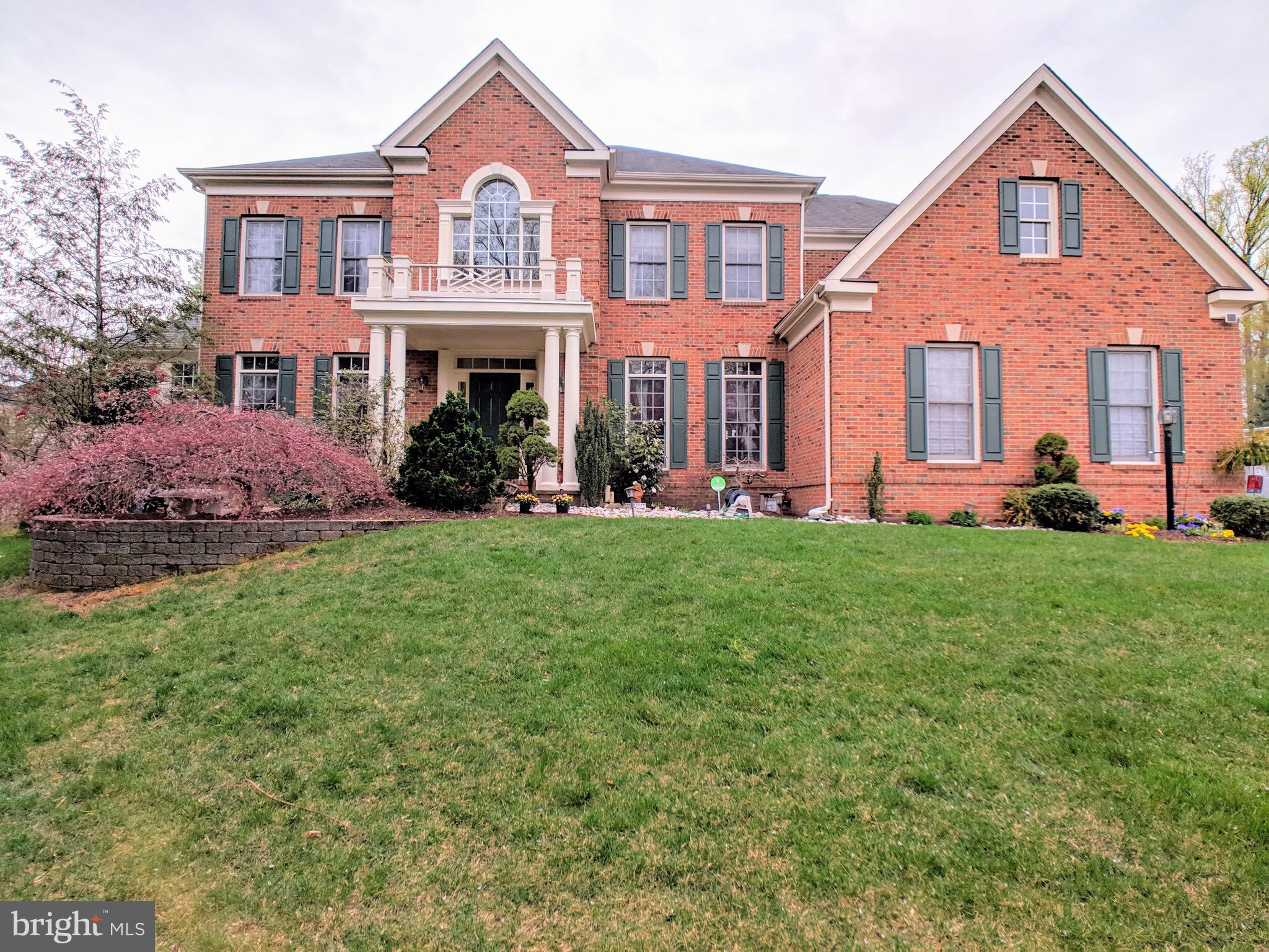 Beautiful brick front home in a sought after West Springfield High school district.  Hardwood floors in amain level, gourmet kitchen with center island.  Fully walk-up basement with media room and full bar.  Landscaping light and sprinkler systems.