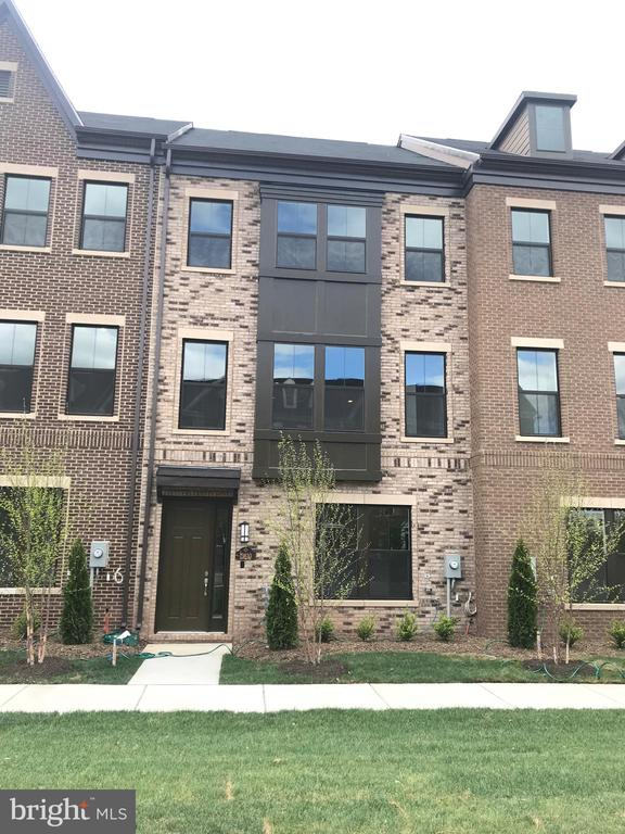 "Beautifully appointed, Brick Front Town home in Prime Location. Open Floor Plan with 5"" Wide Hardwood on entire Main Level, Fireplace and Bookshelves. Chef's Kitchen consisting of Stainless Steel Hood, 5 Burner Cook Top, French Door Refrigerator, Microwave-Oven Combo, Cherry Java Cabinets, Granite Tops and New Smart Home Automation Package. This home includes 3 bedrooms and 3 full baths and 2 1/2 Baths. Private and spacious Rooftop terrace is sure to impress! Close proximity to Dulles Airport, 28, 267, 50, 66, and short distance to Silver Line Metro. PLUS Closing cost assistance available with preferred lender."