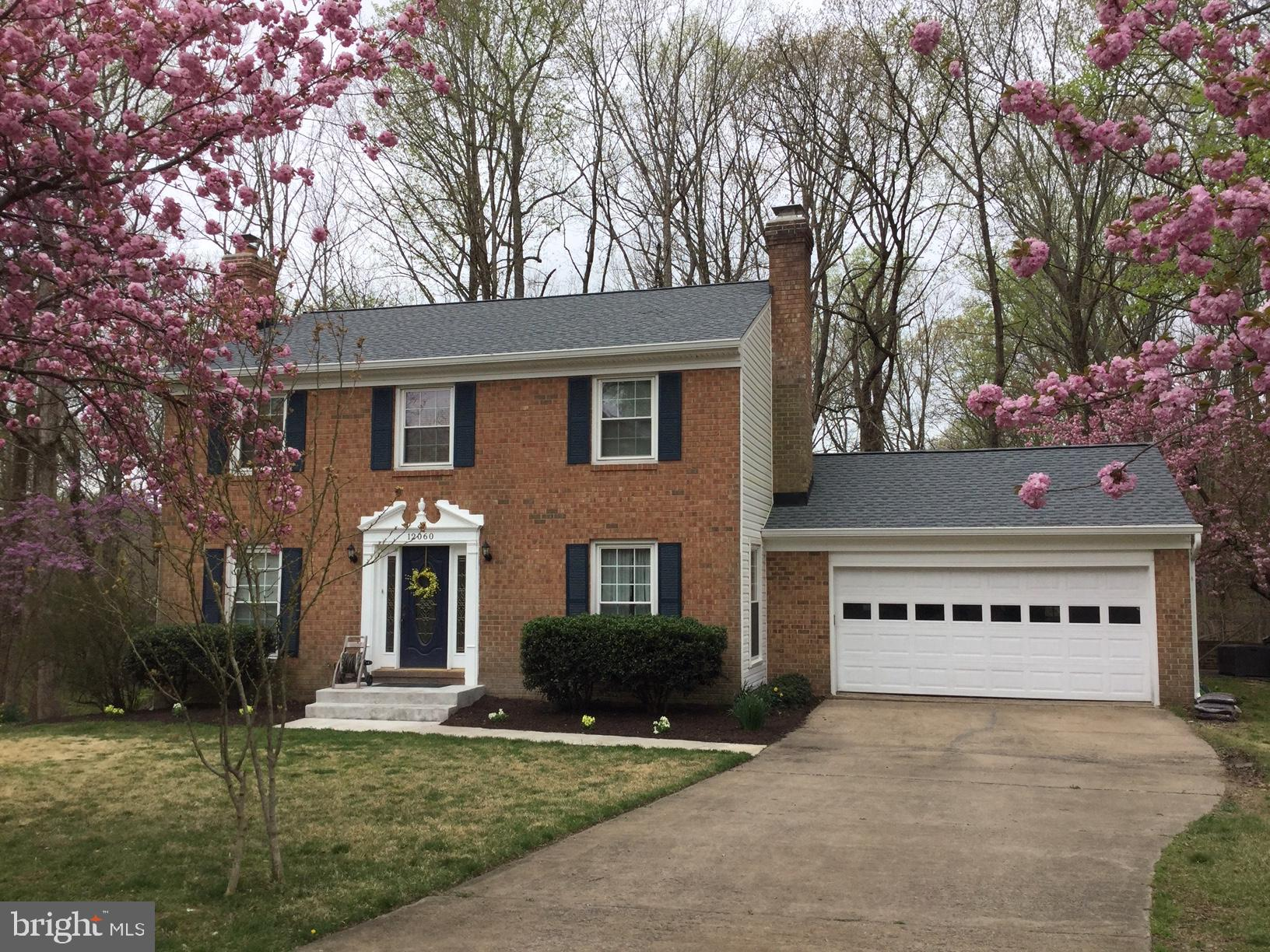 Beautiful Colonial w/Water Views! New roof & siding! 2car garage backing to woods w/Prime Lake Ridge Location! 4BRs/3.5BAs w/3 fin lvls. Hardwood floors on main & upper level, updated baths, formal living & dining rooms, family room off kitchen w/gas FP w/mantel. Upgraded Kitchen w/quartz, xtra cabinets, newer appliances & deck access. Finished basement w/rec room, FP, full bath & walk-out.