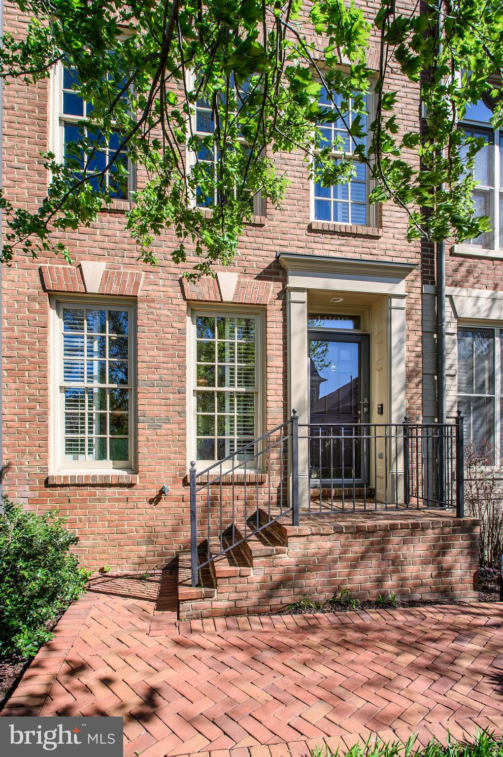Beautiful all brick end unit townhome adjacent to neighborhood outdoor pool. The layout of this home is designed for comfortable living and has an entry level bedroom and bath that other similar models do not have.  The main level boasts an open floor plan and with tons on natural sunlight throughout. There is an array of amenities in this community from clubhouse, exercise room, outdoor heated pool and nature trails.  Minutes from the heart of Old Town Alexandria, and its vibrant waterfront with community shuttle service to the Braddock Road Metro Station; adjacent to the GW Parkway and the Mount Vernon bicycle trail; only two traffic lights to our nation~s capital and Reagan National Airport.