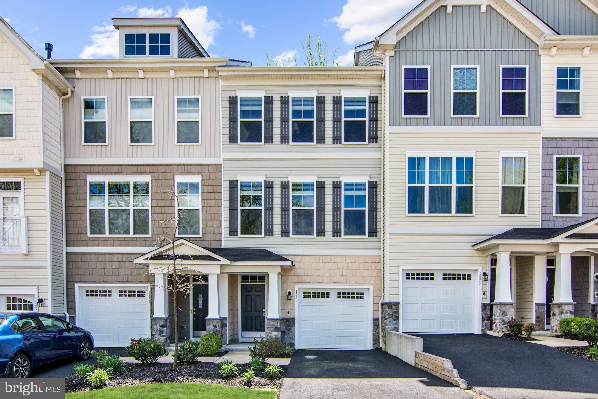 Meticulously maintained 4-year young 1 car garage condo/townhome in desirable Potomac Crest! Features include beautiful hardwood floors throughout the open main level, custom built-in~s, 9 ft ceilings and 2 private decks! The kitchen is a chef~s dream boasting stainless steel, granite, island, breakfast bar and opens to both a cozy sitting area with fireplace and formal dining/living room perfect for entertaining.  Enjoy the well-appointed master suite with a walk-in closet and en suite bath with dual vanities. 2 additional bedrooms upstairs share a bathroom plus laundry for added convenience.  1st level floor with potential for bonus room, full bath and second private deck overlooking wooded area.. Just minutes to VRE/commuter lots, Rt 123/I95, historic Occoquan, shopping, dining & parks