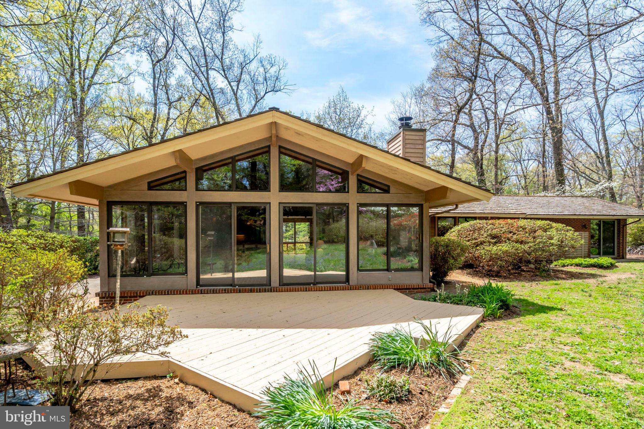 Beautiful Mid-Century Modern home designed by architect owner. Gracious spaces with extensive use of glass and natural materials forge a strong connection with nature. Gorgeous landscaped, private property encompasses 2 ~ lots - over 1.15 acres total.  Open concept, 4 bedroom, 2 bath home inspires wonderful opportunities.