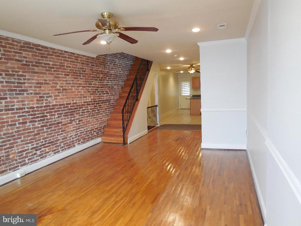 Welcome home to this 3 Bedroom 3.5 Bath Open Floor Plan, Exposed  Brick.  Intercom throughout;         enjoy music while cooking dinner, doing laundry  or soaking in your jetted tub; answer the door        anywhere in the house. Home Warranty & Seller will provide new appliances: Stove, Refrigerator, dishwasher and microwave only.                               Washer and dryer as is.