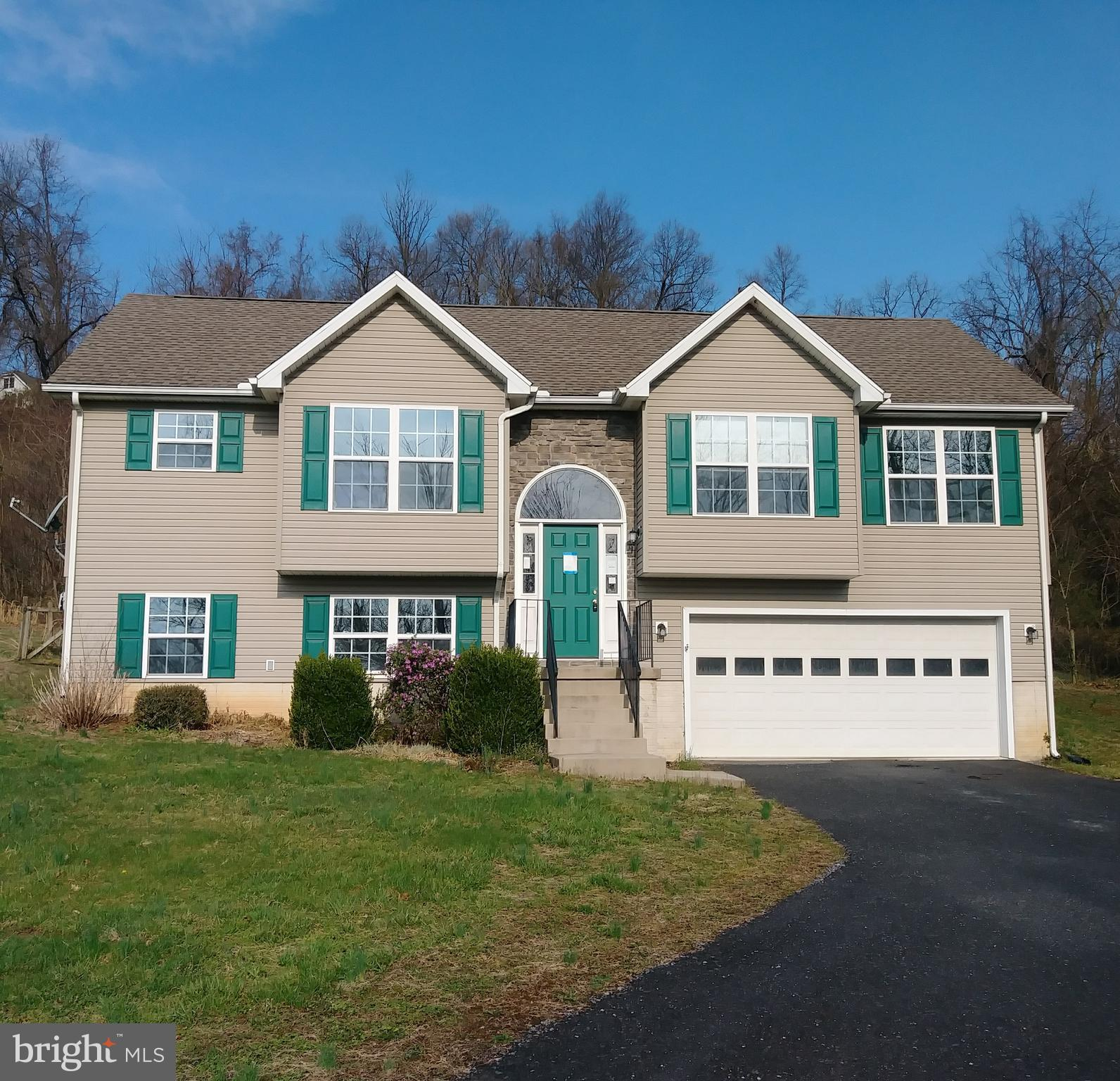 Split Foyer on 1.77 Acres, partially fenced, End corner Lot with wooded area, deck in back of property with entrance through sliding glass doors to Living room, Gas fireplace  in living room, full finished basement with full bath and laundry. Storage  shed on property