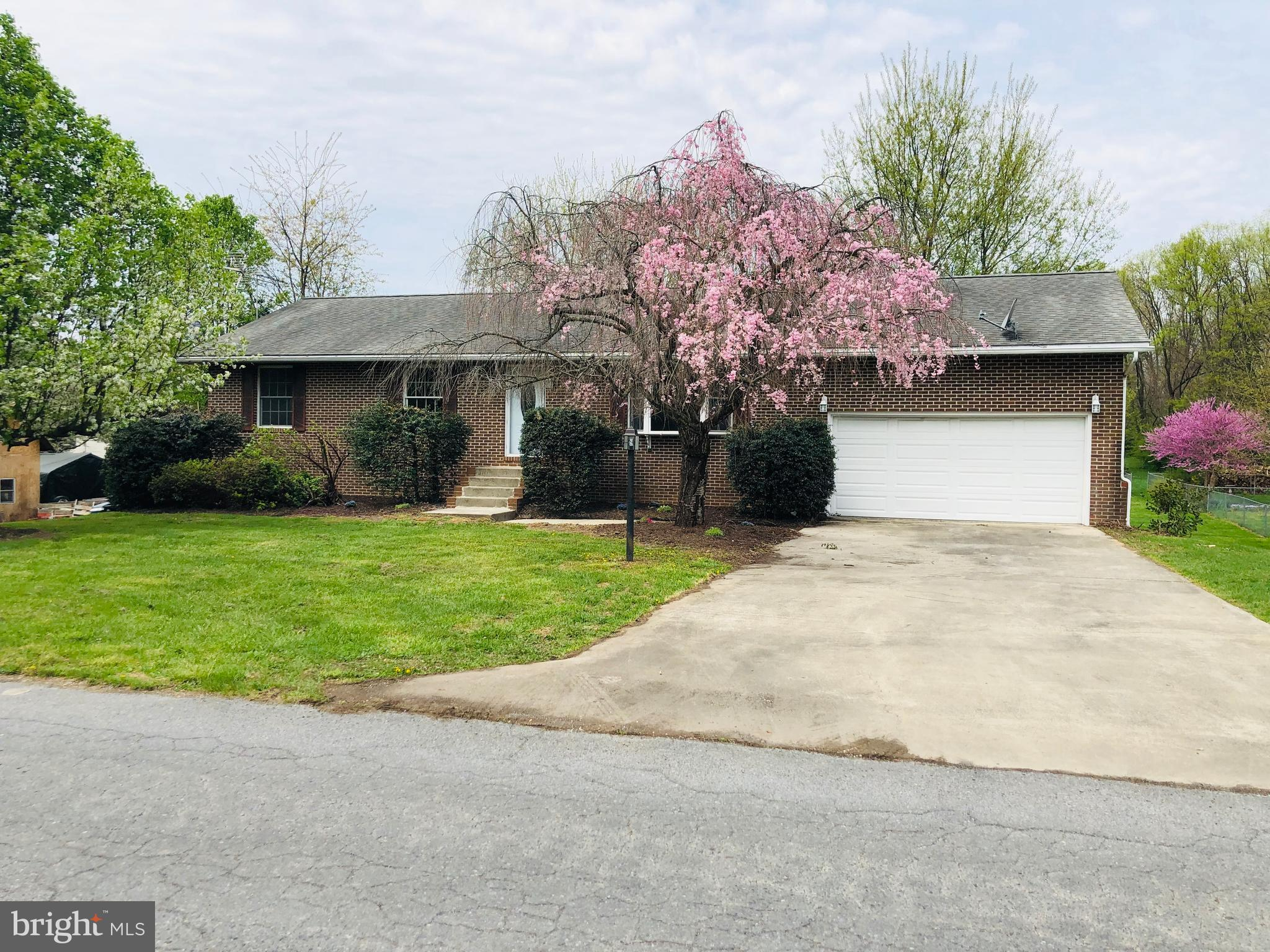 Move in Ready! Home features 4 BRs, 2 full baths, separate dining room, mostly finished basement with unfinished rooms for extra storage, attached 2 car garage with large mud room/ laundry room, all new appliances and rear deck. Seller offering a Home Warranty