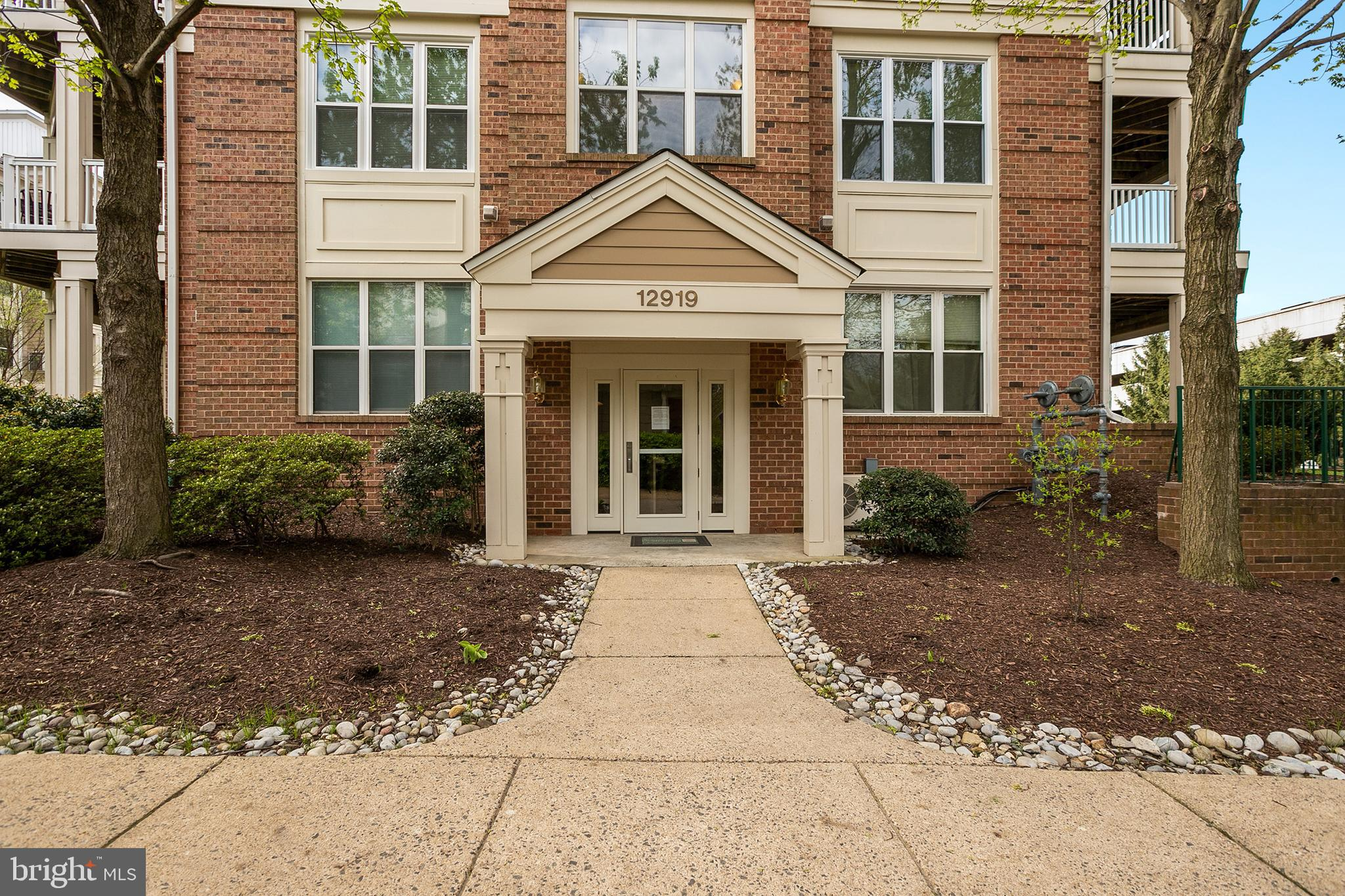 Location, Location!  Close to future Herndon metro station shops and commuting access.  This Worldgate condo is move-in ready with brand new paint, carpet and water heater.  Living and dining areas are warmed by a fireplace. The master bedroom offers a large walk-in closet. All windows and slider door in process of replacement.  The Worldgate community is only 1/4 mile to Worldgate Center with theater, restaurants, Sport & Health Club, and is just minutes to Dulles Airport. The condo association offers two swimming pools, clubhouse, fitness center, underground parking, secure entrance, and elevators.