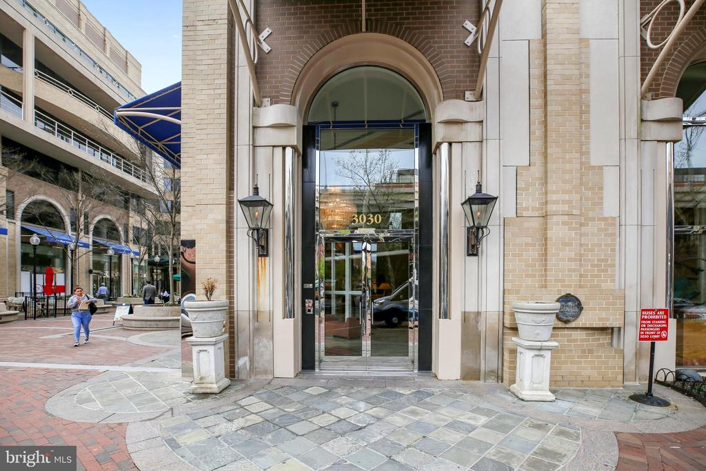 Now is the perfect time to enjoy waterfront living in Georgetown!  Gorgeous views of Key Bridge from private terrace.  Concierge staff 24/7.  Pool and Fitness Room all included.  Two bedroom with two and one half bathrooms.  Living room with fireplace and wetbar with mini refrigerator.  Spacious kitchen.  Don't miss the elegant master bathroom.   Garage parking (P112) included.