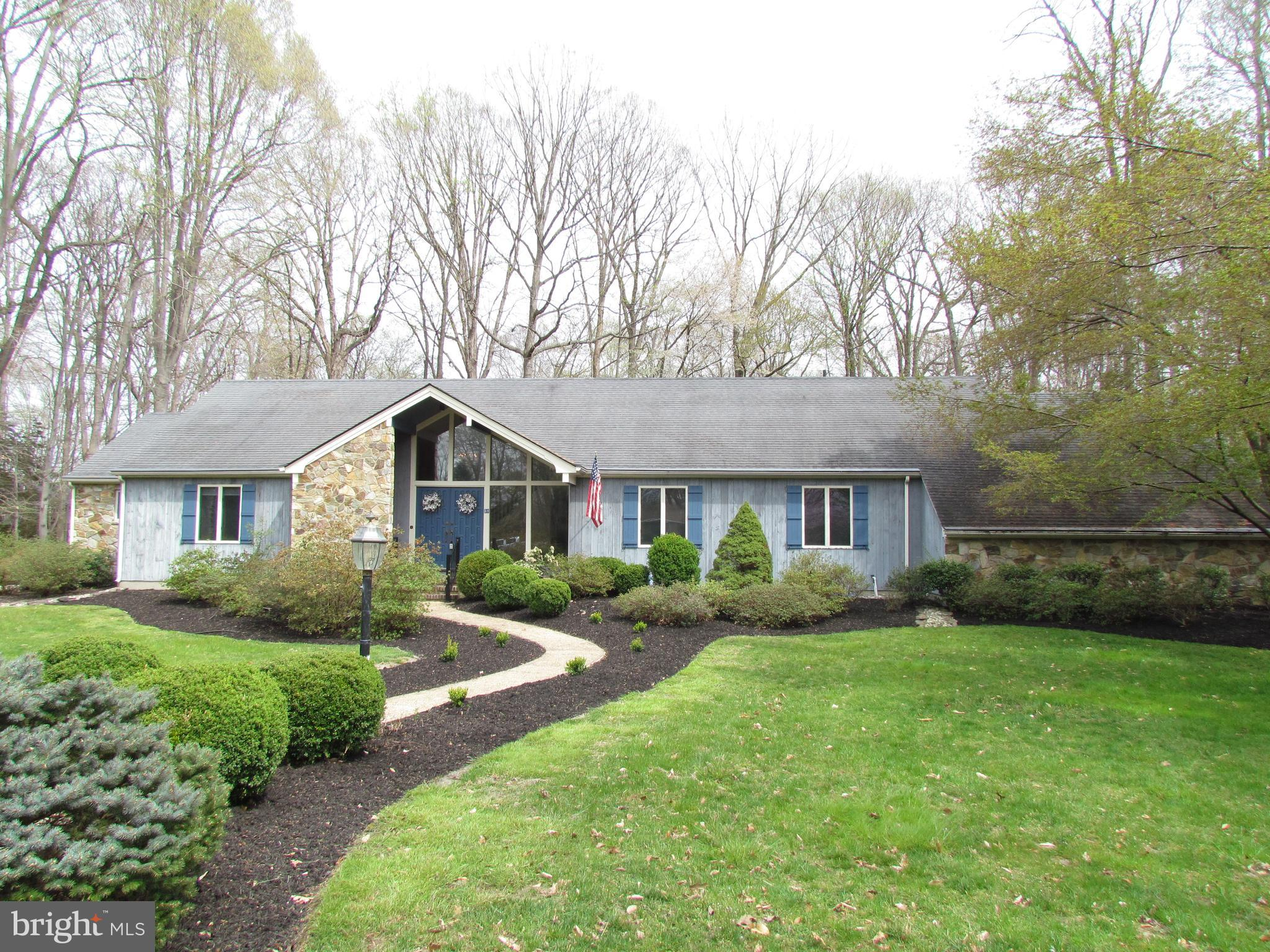 This beautiful custom home is nestled in a quiet culde sac.  The beautiful landscaped lawn invites you into the stone front entrance.  Open the door to an open two story foyer.  The living room and dining room is light and airy and has beautiful hardwood flooring.  The family room is expansive with a cathedral ceiling and a floor to ceiling stone fireplace with nice windows letting the natural light inside.  Step out to the the heated and cooled sun room to enjoy the outdoors from inside with skylights to make it cheerful and bright.  The large kitchen has an abundance of counter and cabinet space, Viking double wall ovens, a cook-top, and a quiet Bosch dishwasher.  Steps from the kitchen is a half bath, office and mudroom.  The master suite is on the first floor with his and her vanities a whirlpool, and separate shower.  The finished basement has two large rec areas and a bedroom with an outside egress, and a full bath.  Outside you will find a lovely outdoor entertainment area with a built in stone grill.  The lot is beautiful and private.  Don't miss the opportunity to view this great home!