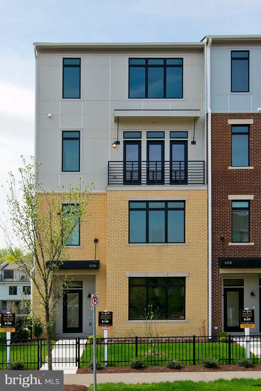New to the Village at Leesburg community is this Bluemont Condo at the Lofts at Village Walk. As a resident of the Lofts you will experience luxury living with unlimited access to amenities. This neighborhood is one of a kind in location to commuter routes just off of Route 7,15 and 267 . This townhouse style condo is 2488 sf of exceptional finishes featuring an open concept layout with hardwood floors throughout the entire main level. The kitchen has premium stainless appliances, white cabinets and elegant granite counters. The opulence continues in the master bath with oversized modern tile on the floor and shower surround, and separate soaking tub. Unwind on your upstairs balcony or explore the dining, shopping and entertainment just outside your front door. With community events, ample restaurants and outdoor trails, there is something for everyone! Models now open 10am-5pm Monday Through Friday and open 11am-6pm Saturday and Sunday. **Photos of Decorated Model for illustrative purposes only.  **