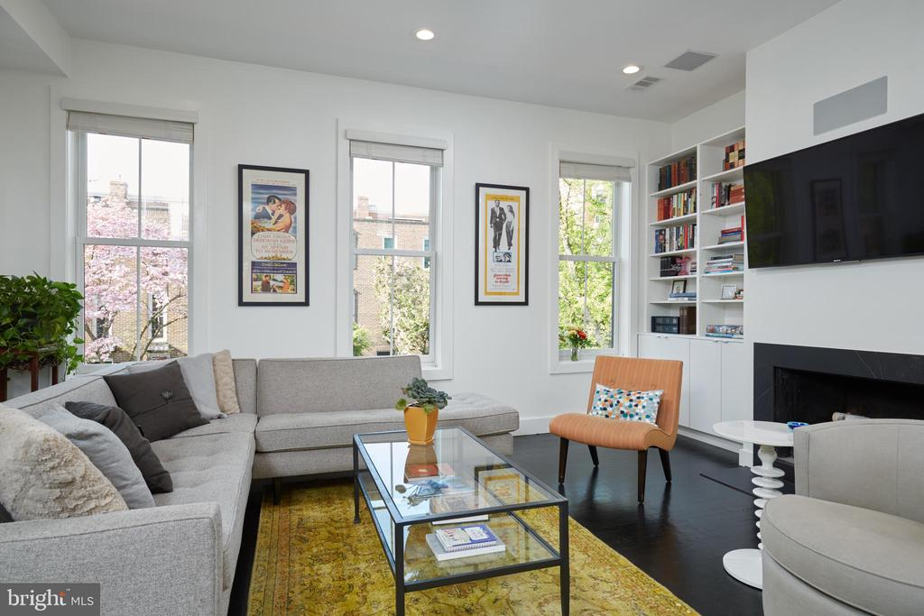 A gem in the heart of Logan Circle. This fully renovated 3 bedroom, 3 full and one half bathroom townhome stretches out over three levels, with a flexible floor plan. A modern and stylish mix of space, finishes, and location, this 1880 Federal home boasts open and light-filled living spaces. The home is punctuated with beautiful details including stunning hardwoods, soaring ceilings, two wood-burning fireplaces, and custom built-ins. The living room is exceptional, completely sun-drenched with oversized windows and room to stretch out. This flows right to the Chef's kitchen, outfitted with top-of-the-line stainless steel appliances, including sub-zero refrigeration and a Bosch suite. An amazing bonus to the home is the screened in porch -- creating an oasis in the middle of the city. The Owner's Suite is truly spectacular, adorned with vaulted ceilings, a fireplace, spa-like ensuite bathroom with a large double vanity, and a spacious walk-in closet. This home has the incredible opportunity to be converted back into a separately metered two-unit unit home. The possibilities are endless here- think rental potential, au pair suite, in-law suite, and more. Finally, the two car parking is what makes this opportunity one that cannot be missed. The vibrancy and convenience of this prized location speaks for itself. Near the METRO, a multitude of green spaces, and some of the city's most sought after shopping, dining, and socializing establishments, this premier Logan Circle residence is an exceptional place to call home.