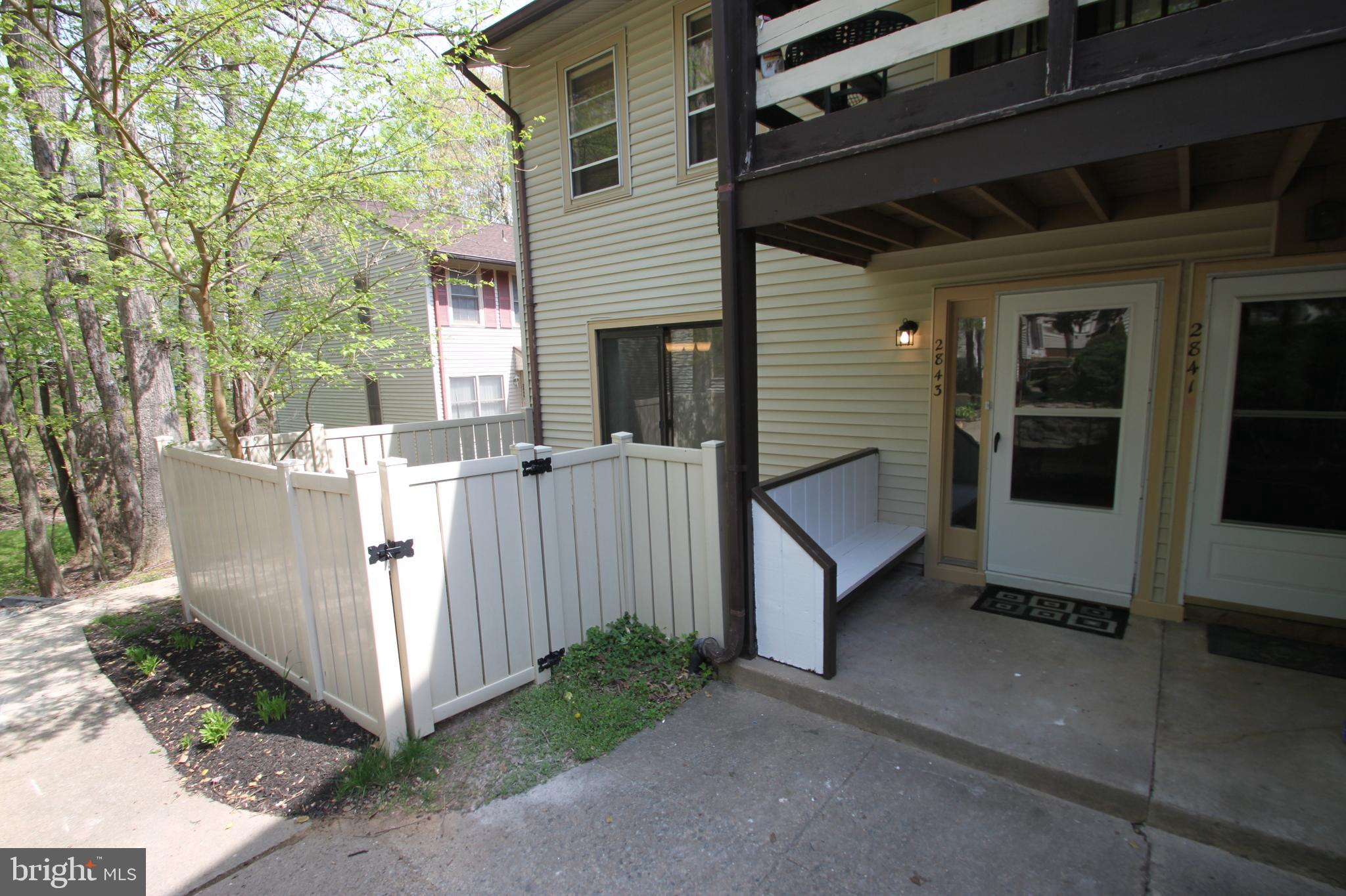"WOW! Beautiful top to bottom renovation! You are greeted with NEW flooring throughout, fresh paint, a cozy fireplace, and separate dining area. Kitchen has NEW shaker cabinets, NEW granite counters, NEW stainless steel appliances (incl dishwasher). Bathroom is ALL NEW with custom tile work. Two good sized bedrooms with plenty of storage. Relax outside in your own private, fenced area. Washer/dryer. New CPVC piping throughout. Easy one level living without the ""apartment"" feel. You will love this place! NOTE: No sign at property (look for Sentrilock). Home is located in quiet cluster. Read directions to see how to get from parking to door."