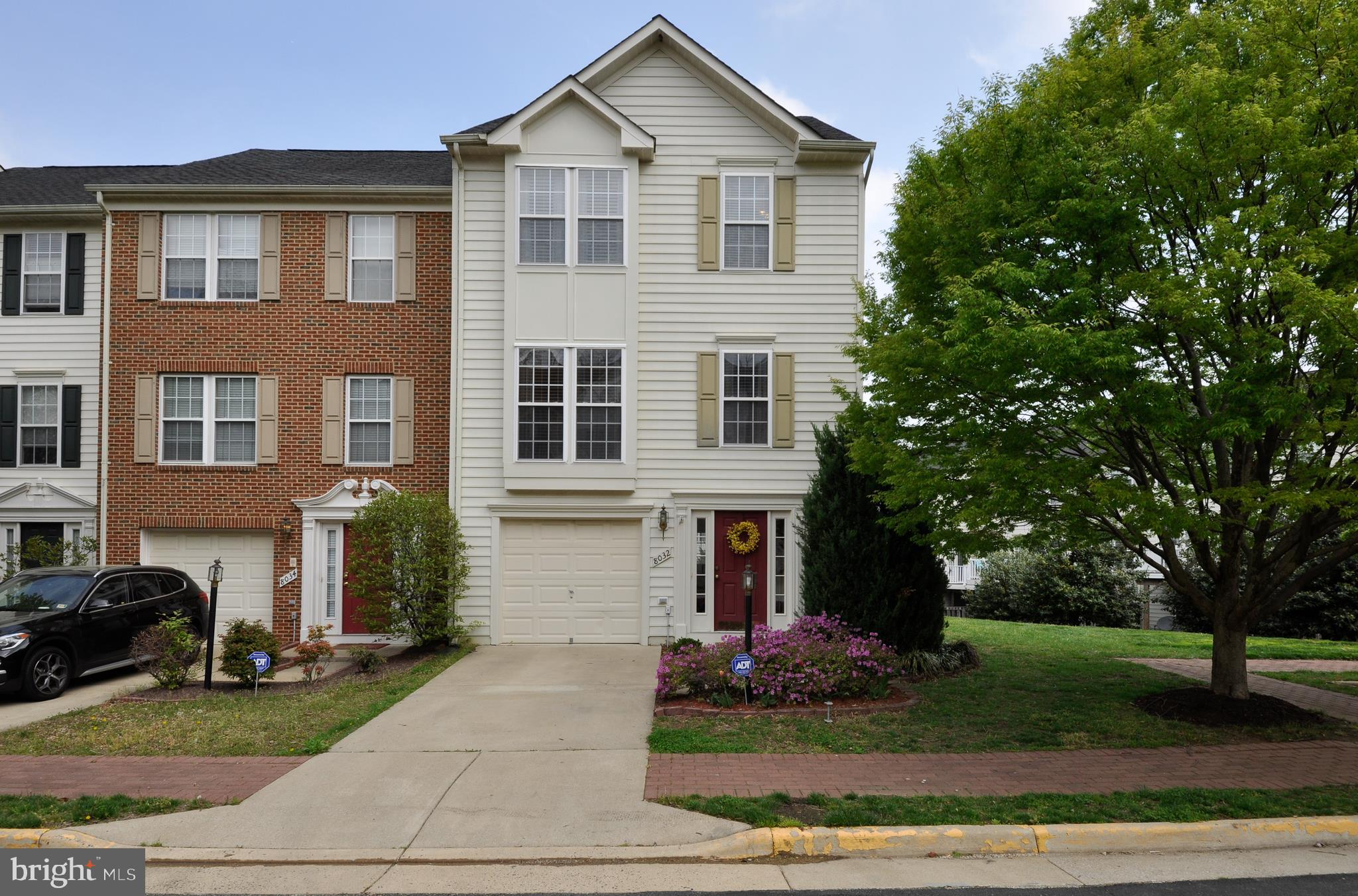 Beautiful end-unit townhome in Lorton Station South! New carpet, new granite countertops (installed after pics!), gleaming hardwood floors throughout main level, sunroom/dining area, 3 finished levels, deck, patio, fenced in backyard! All in an amenity filled community close to everything (minutes to VRE, I95, Ft. Belvoir..walk to shopping and dining!). Don't miss this one!