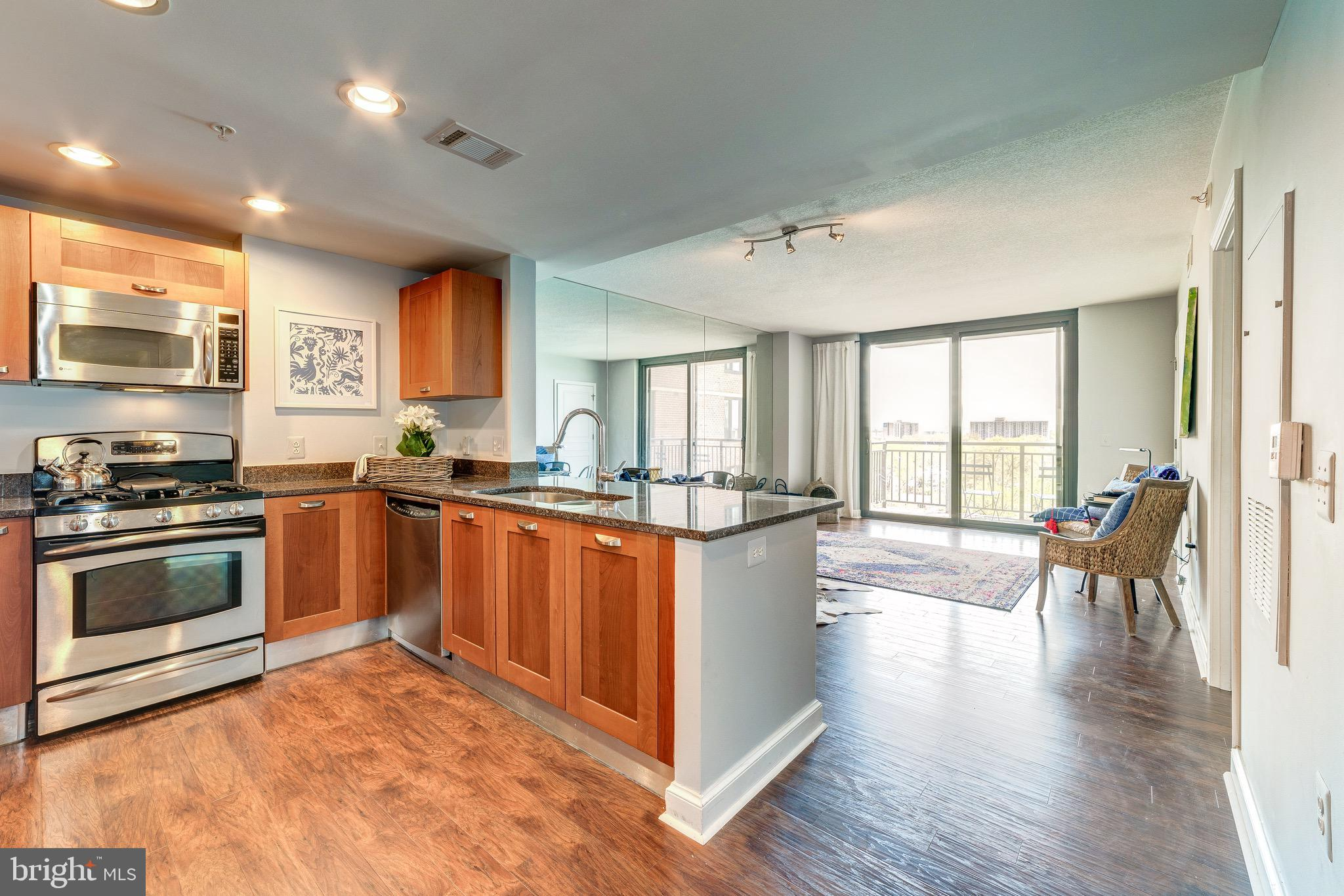 Stunning condo in the sought after Midtown Alexandria area. Recently renovated with new hardwood floors, freshly painted and much more! This unit also comes with it's own assigned parking spot G350 which is located right next to door into  the building and one of the largest storage units  located on the fifth floor !!! $3,000 water heater was just installed! Amenities include an expansive swimming pool with spa and waterfall, fitness club, tiki bar, cyber caf~, residents~ clubroom and 24-hour front desk. Located right next to the Huntington Metro station with a view that will blow you away, this is a home you don't want to miss! Great location for members of the Amazon family moving to the area. COMES WITH A  HOME WARRANTY